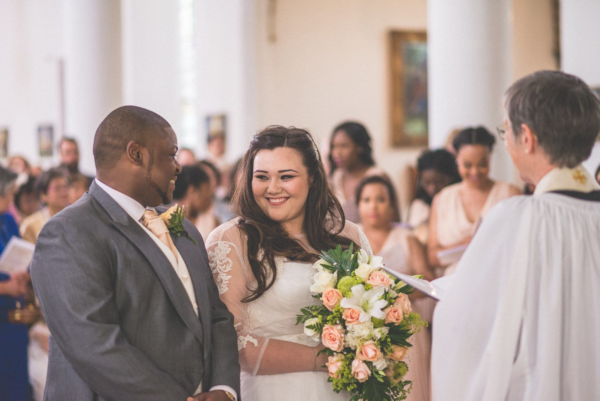 Bride and Groom smile at each other at their wedding ceremony