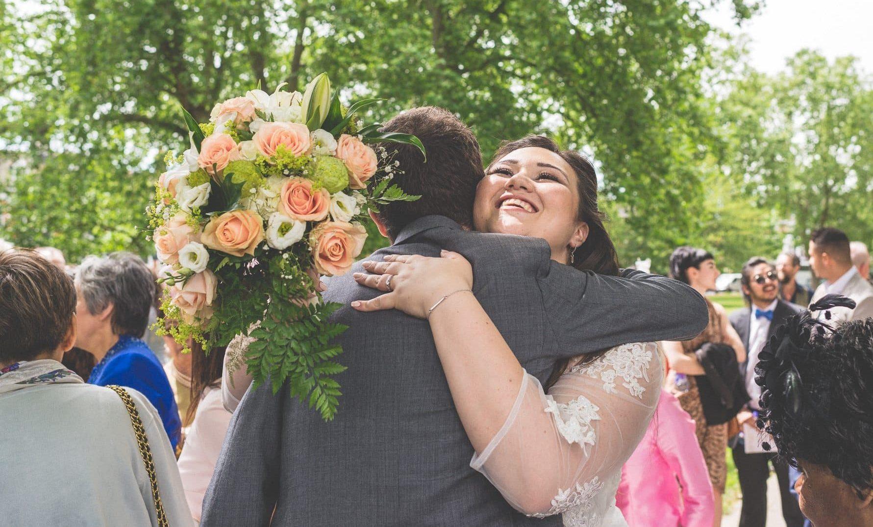 Thai Bride hugging a wedding guest