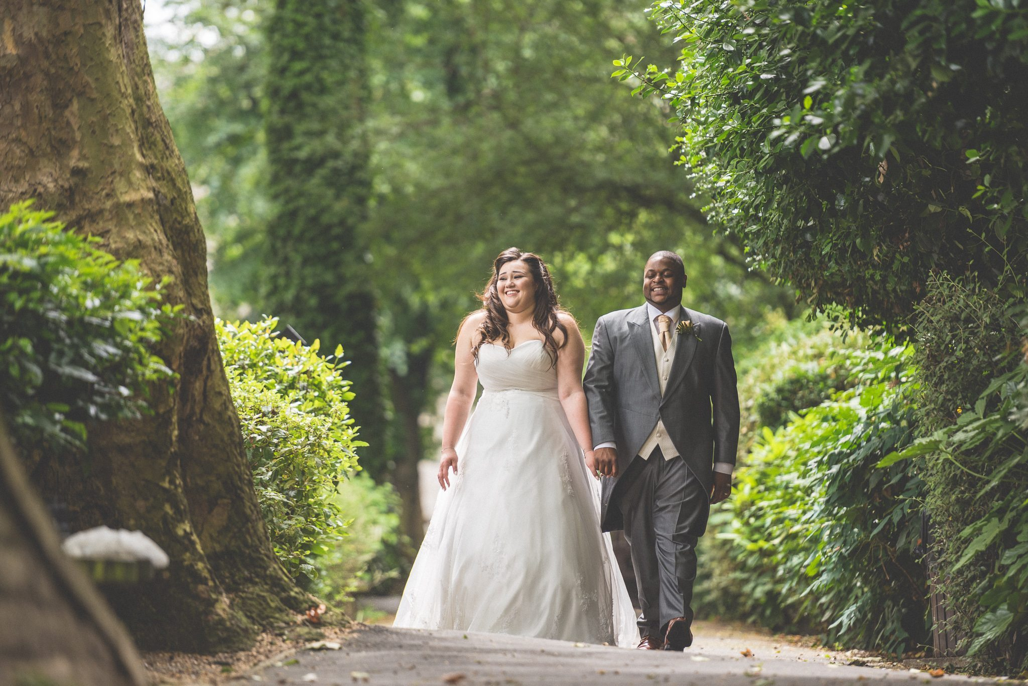 Bride and Groom walking down an alley and laughing