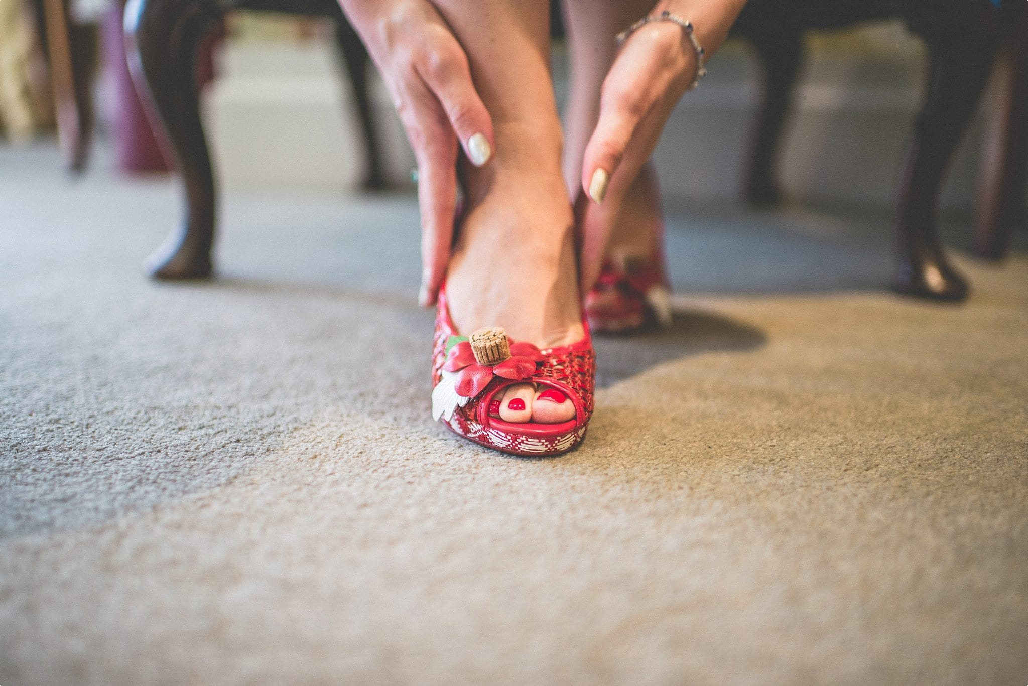 Red wedding shoes of the bride at the Elvetham Hotel