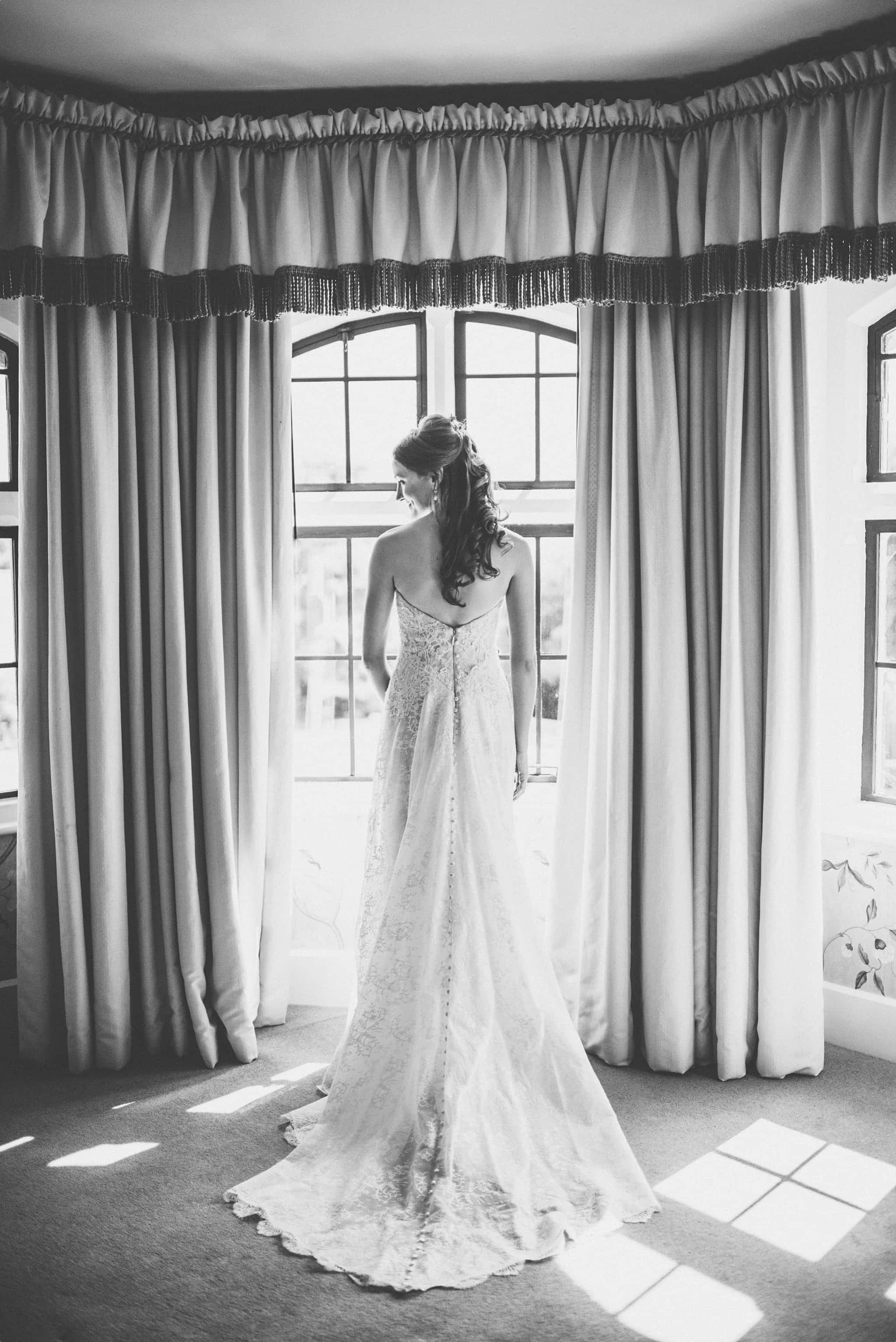 Bride looking out of the window at the elvetham hotel