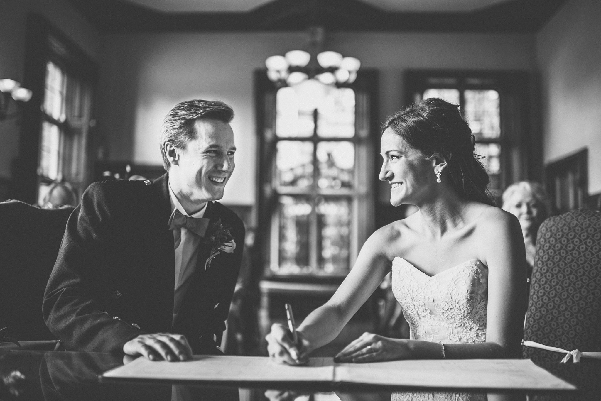 Bride and groom smiling at each other at their Elvetham Hotel wedding ceremony
