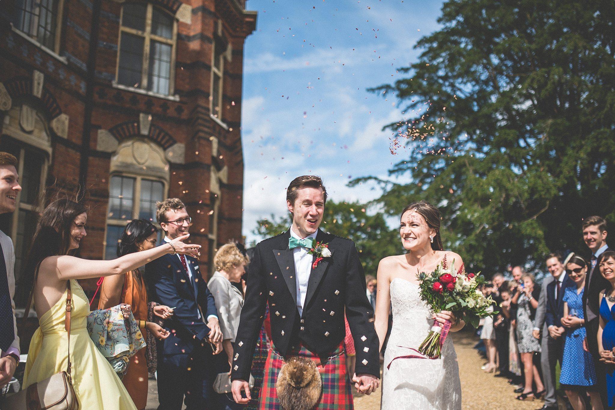 Elvetham Hotel Bride and Groom walking through wedding confetti