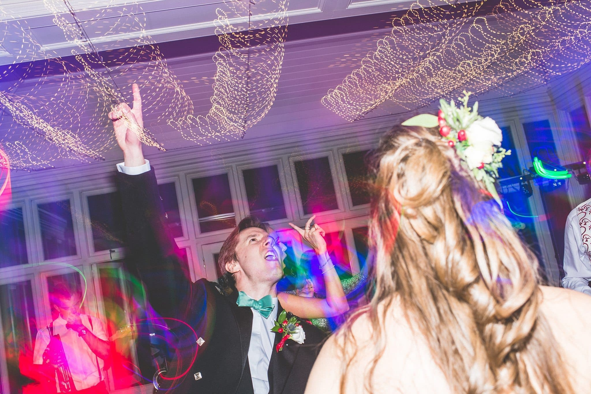 Bride and groom singing and dancing at the Elvetham Hotel
