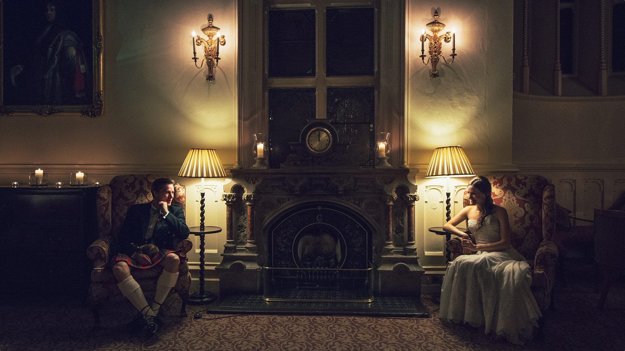 Bride and groom sitting in lamp light at the Elvetham Hotel