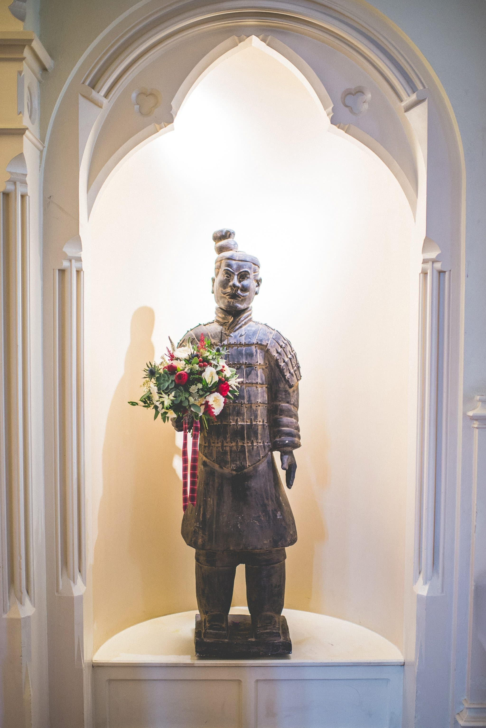 Elvetham Hotel Chinese warrior holding the bride's bouquet