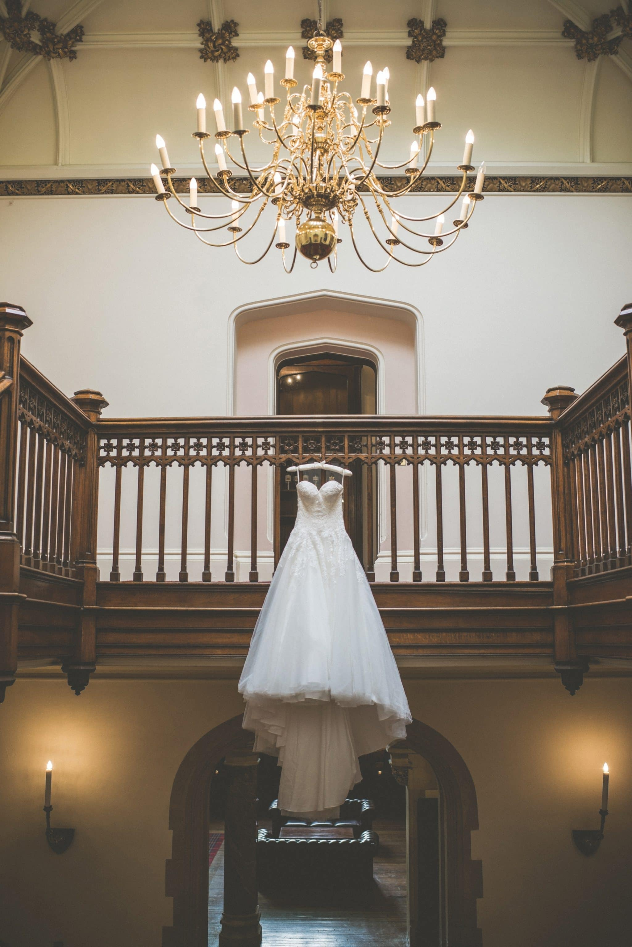 Wedding dress handing over the grand staircase at St Audries Park