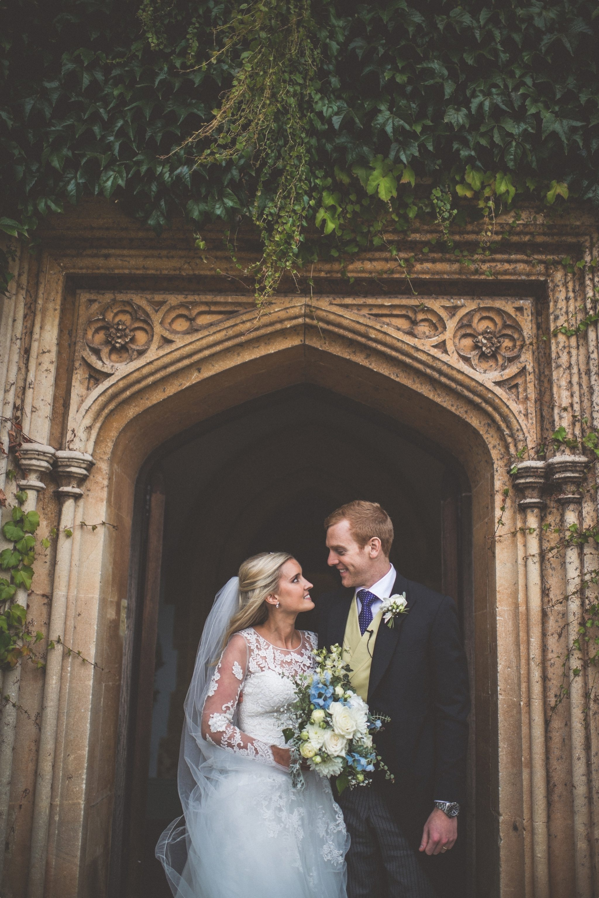 Bride and Groom standing in the doorway at St Audries Park