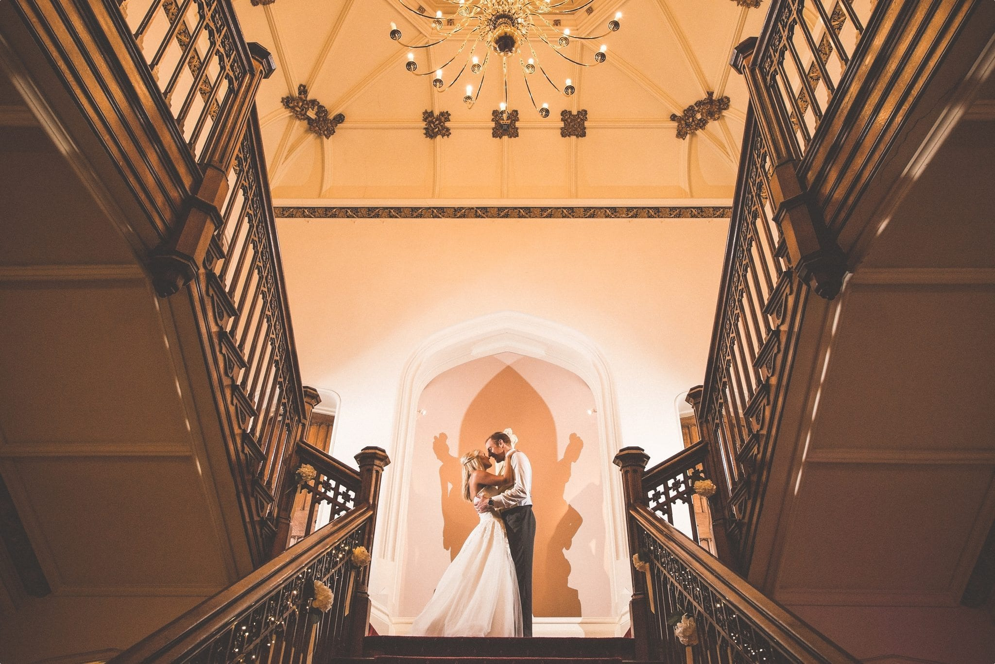 St Audries Park grand staircase creative night shot of married couple