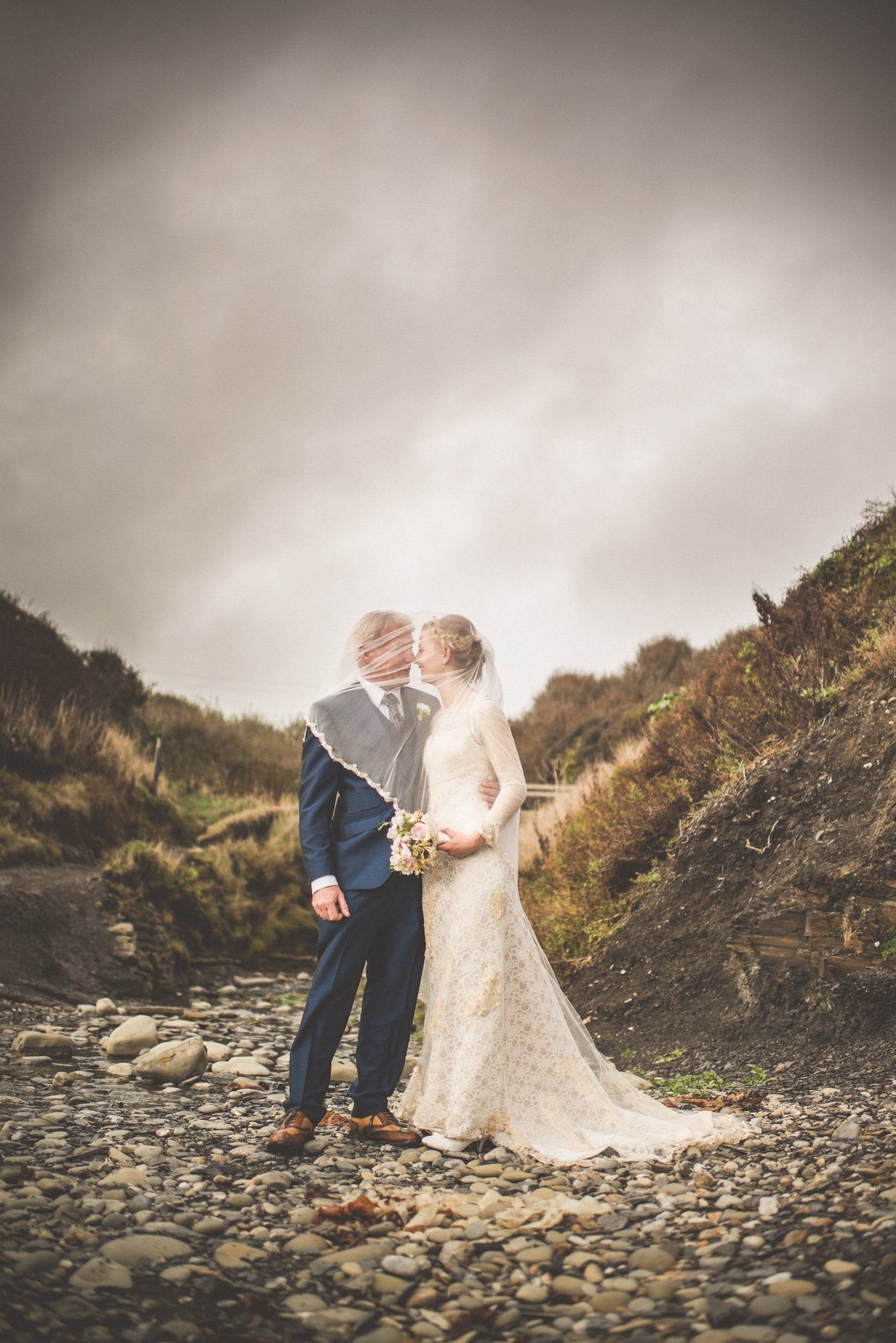 Bride Bea and Groom Jason pose for portrait shots in Kimmeridge Bay