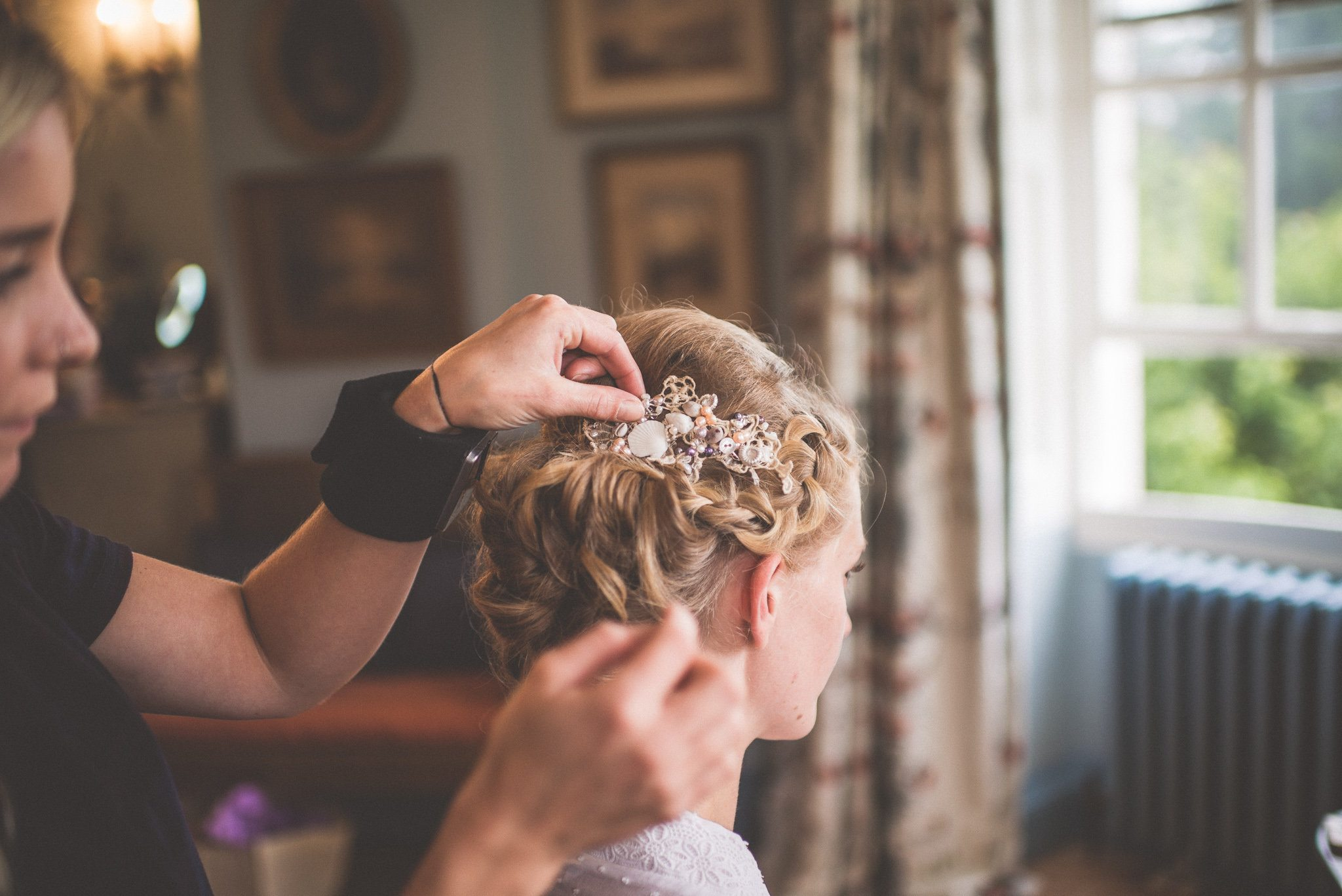 Bride Bea has her hair done before her wedding