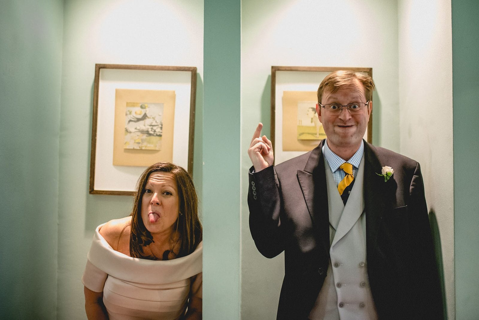 Bride and groom pulling faces at their luxury Chelsea Bluebird London Wedding