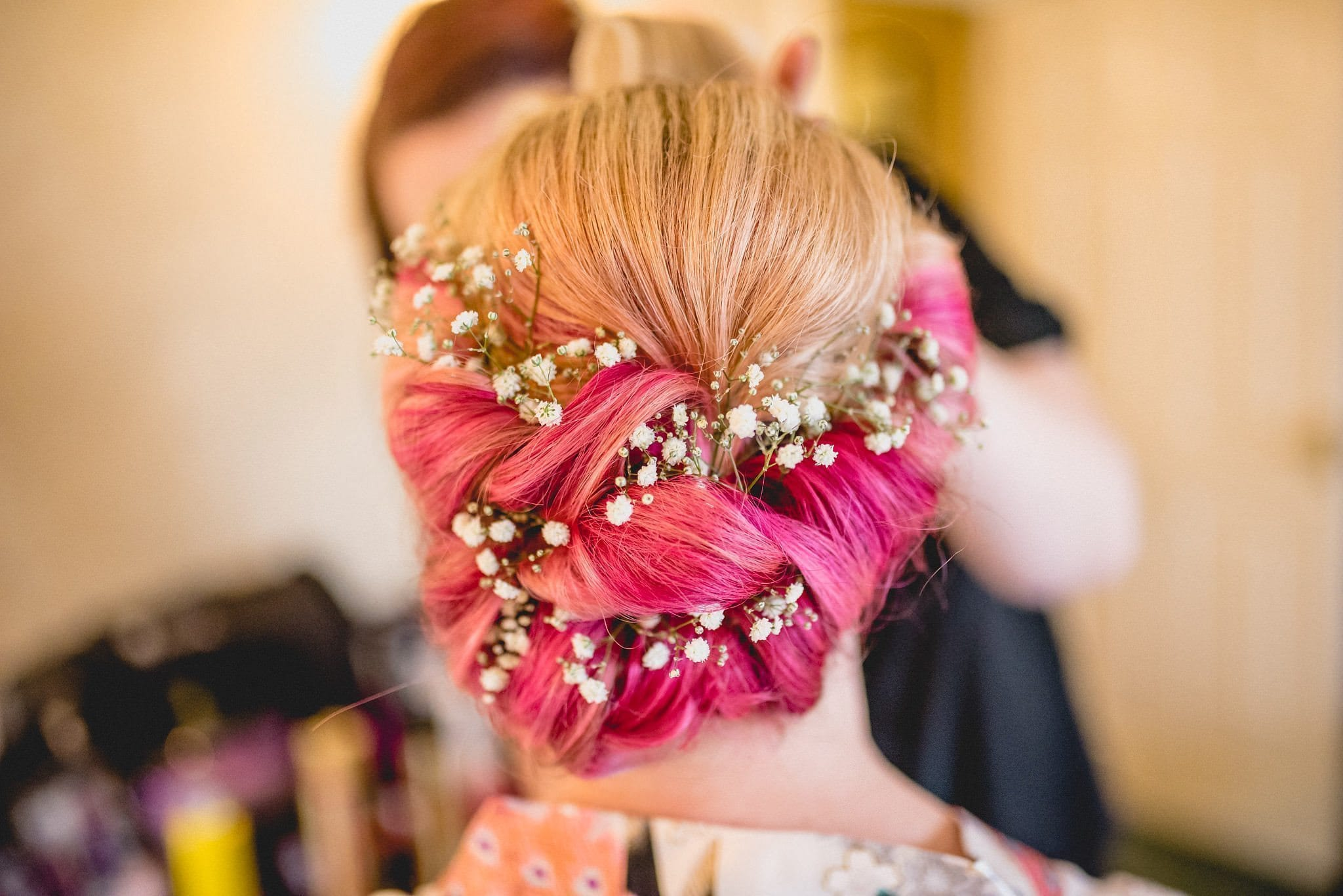 Bride's pink hair threaded with gypsophila for her quirky Birtsmorton Court wedding