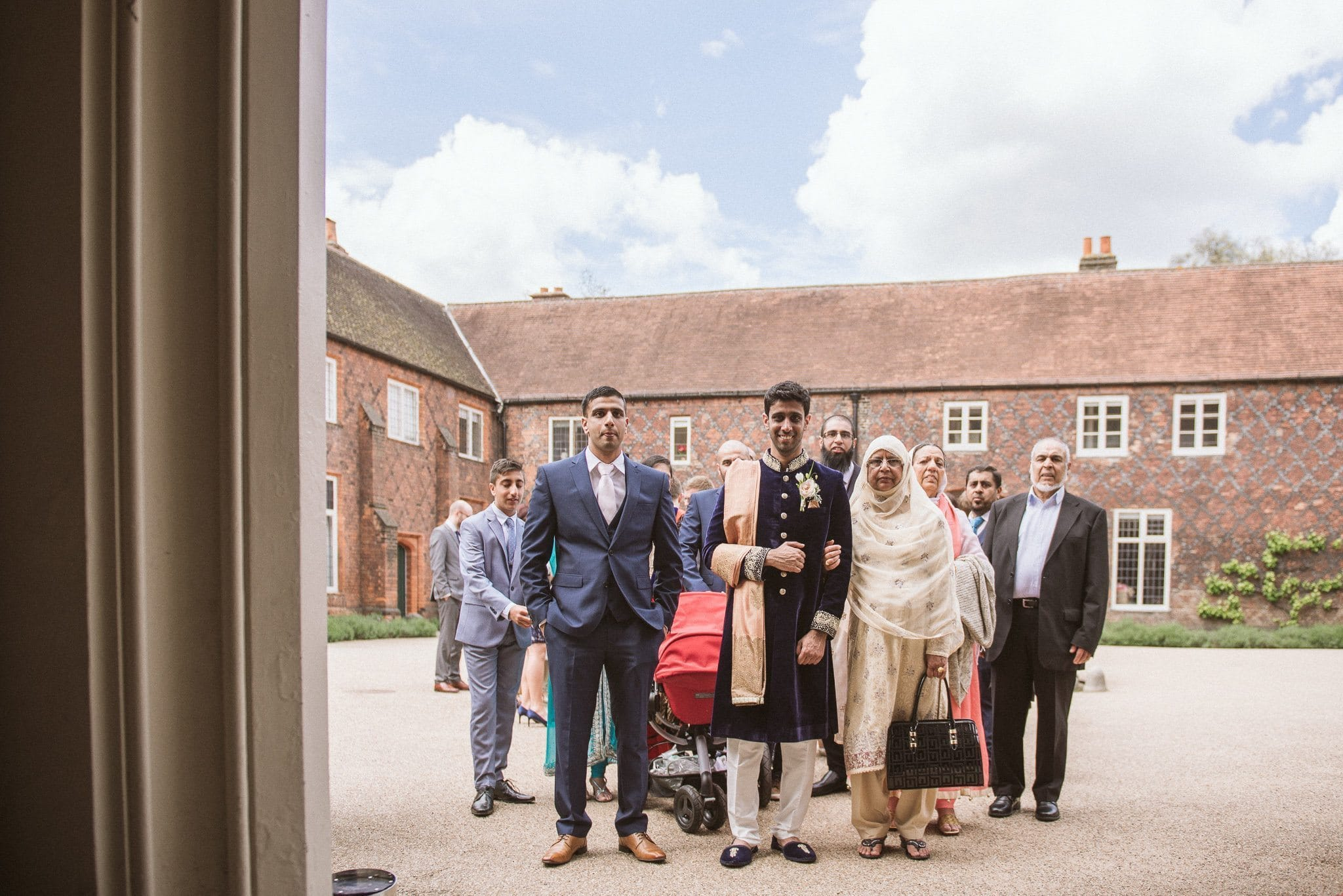 Usman and his family arrive on foot at Fulham Palace for his wedding ceremony