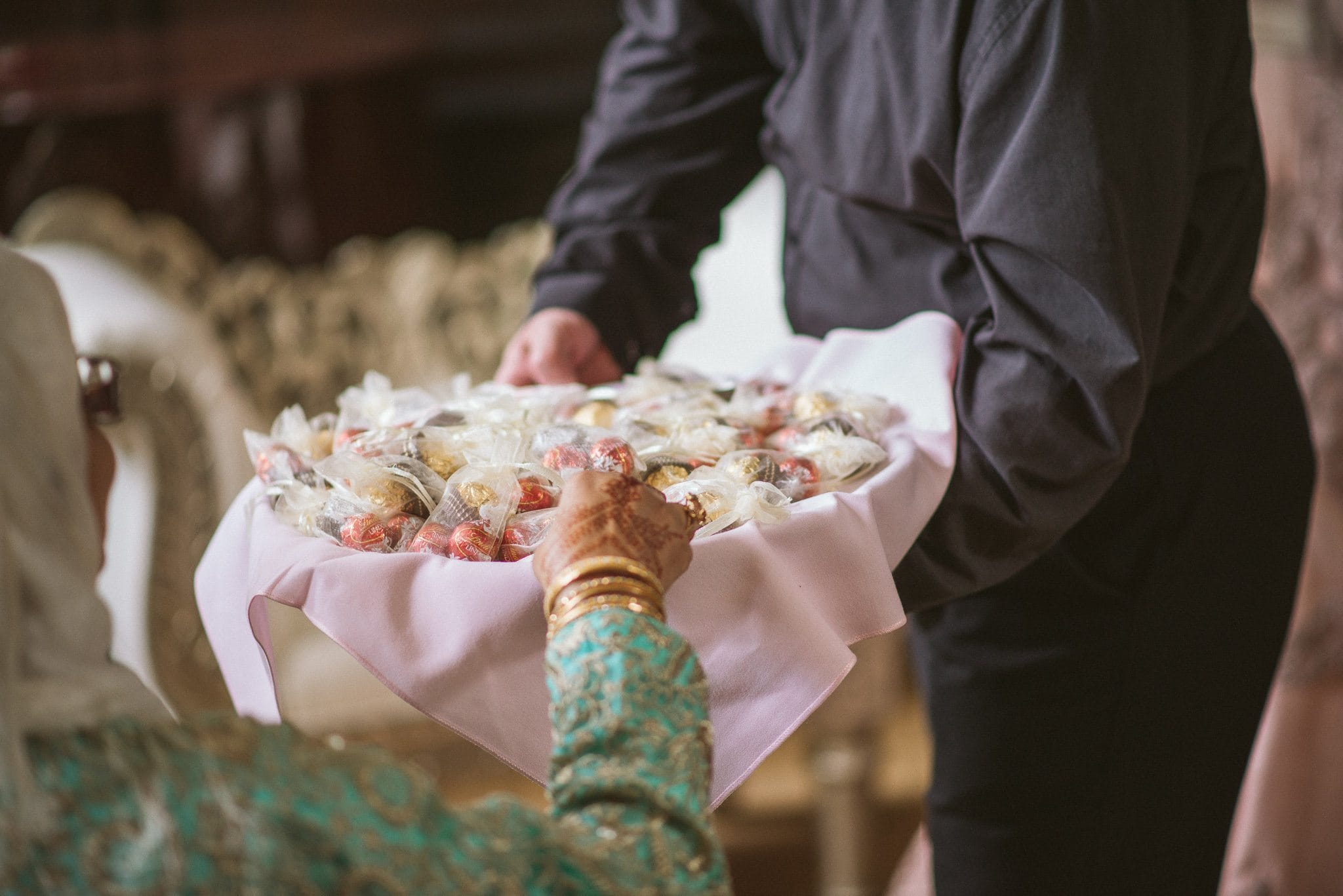 Traditional sweets are handed out from a basket at the end of the wedding ceremony