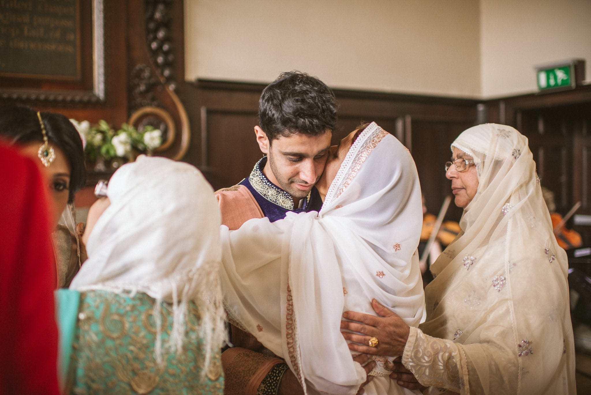 Usman is hugged by a female guest after his wedding ceremony
