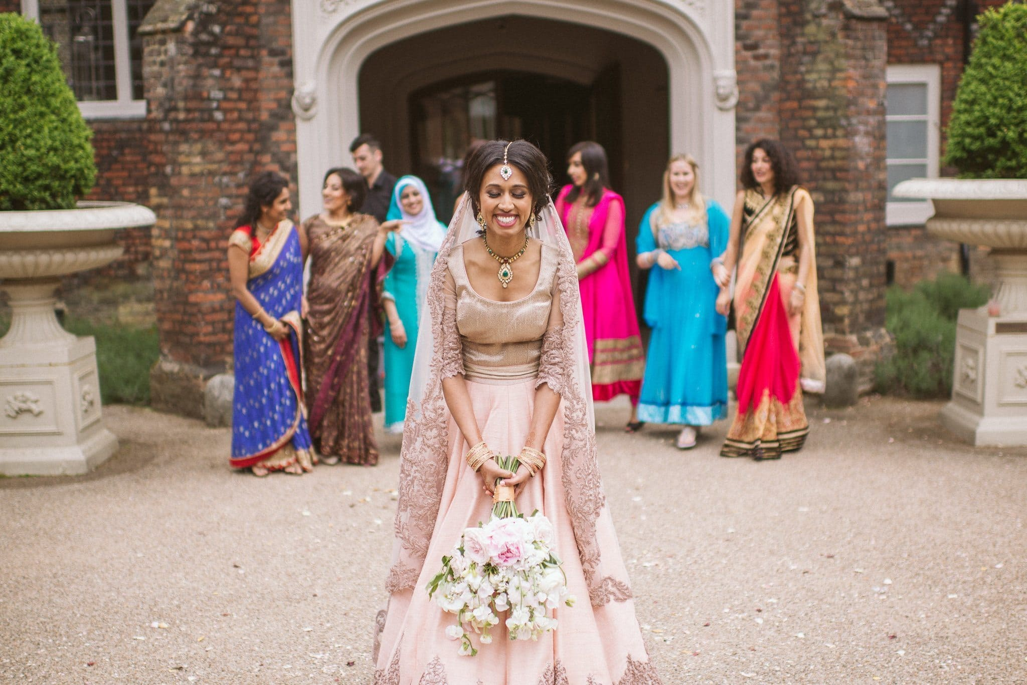 Sorayya prepares to throw her bouquet to a crowd of female guests in brightly coloured saris