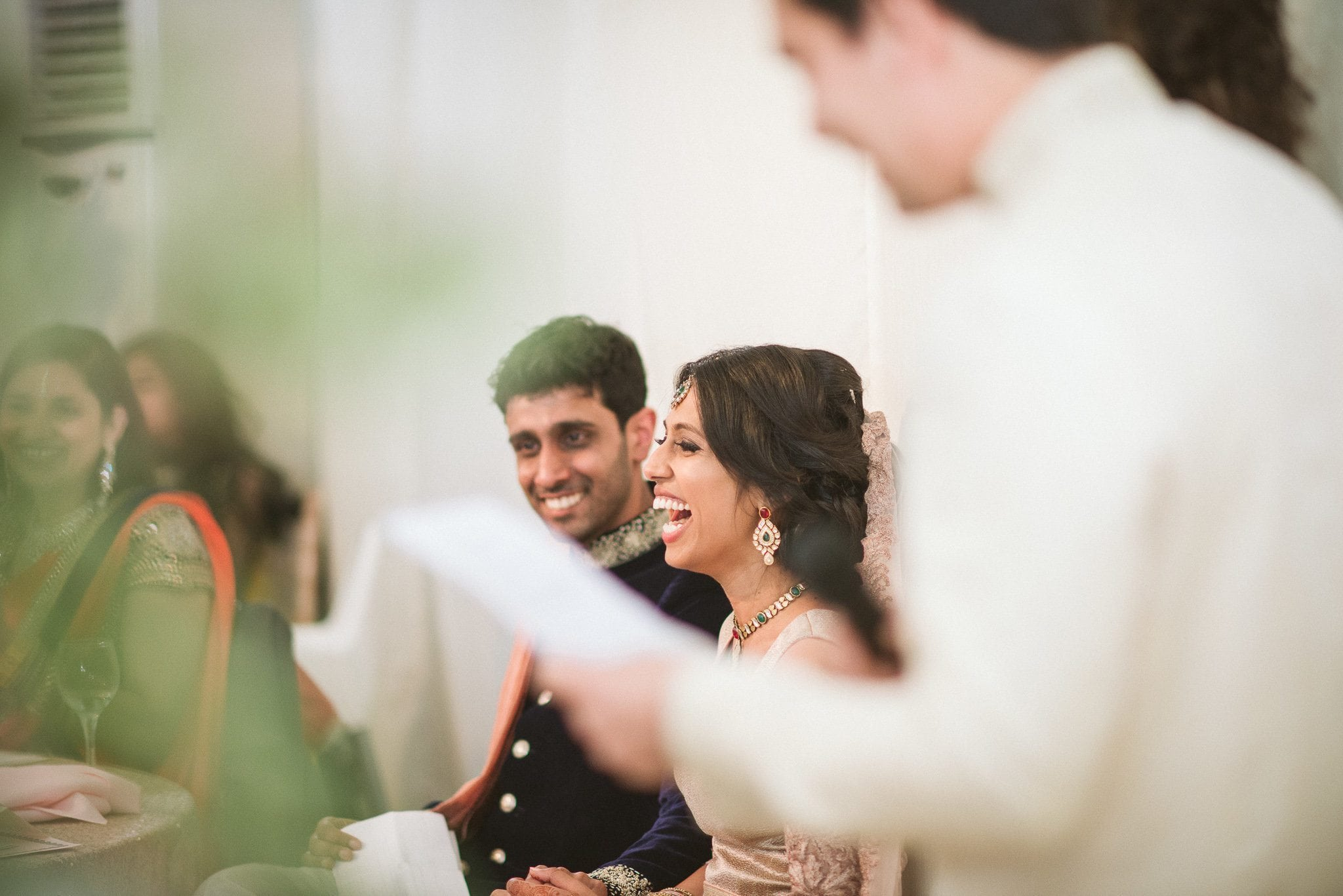 Sorayya and Usman burst out laughing during the speeches at their colourful Muslim Fulham Palace Wedding