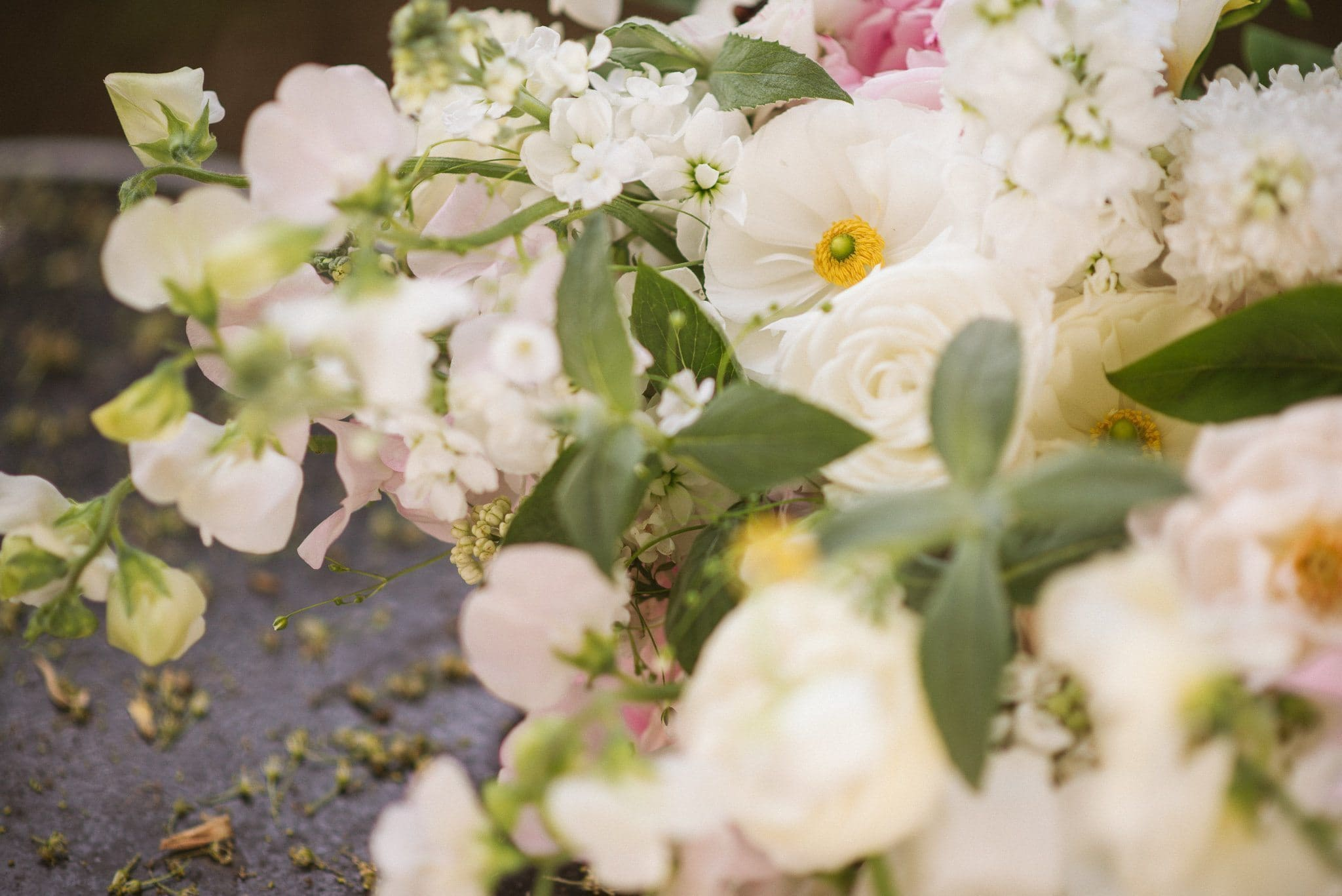 A close up shot of Sorayya's wedding bouquet, featuring loose white, cream and pale pink blooms