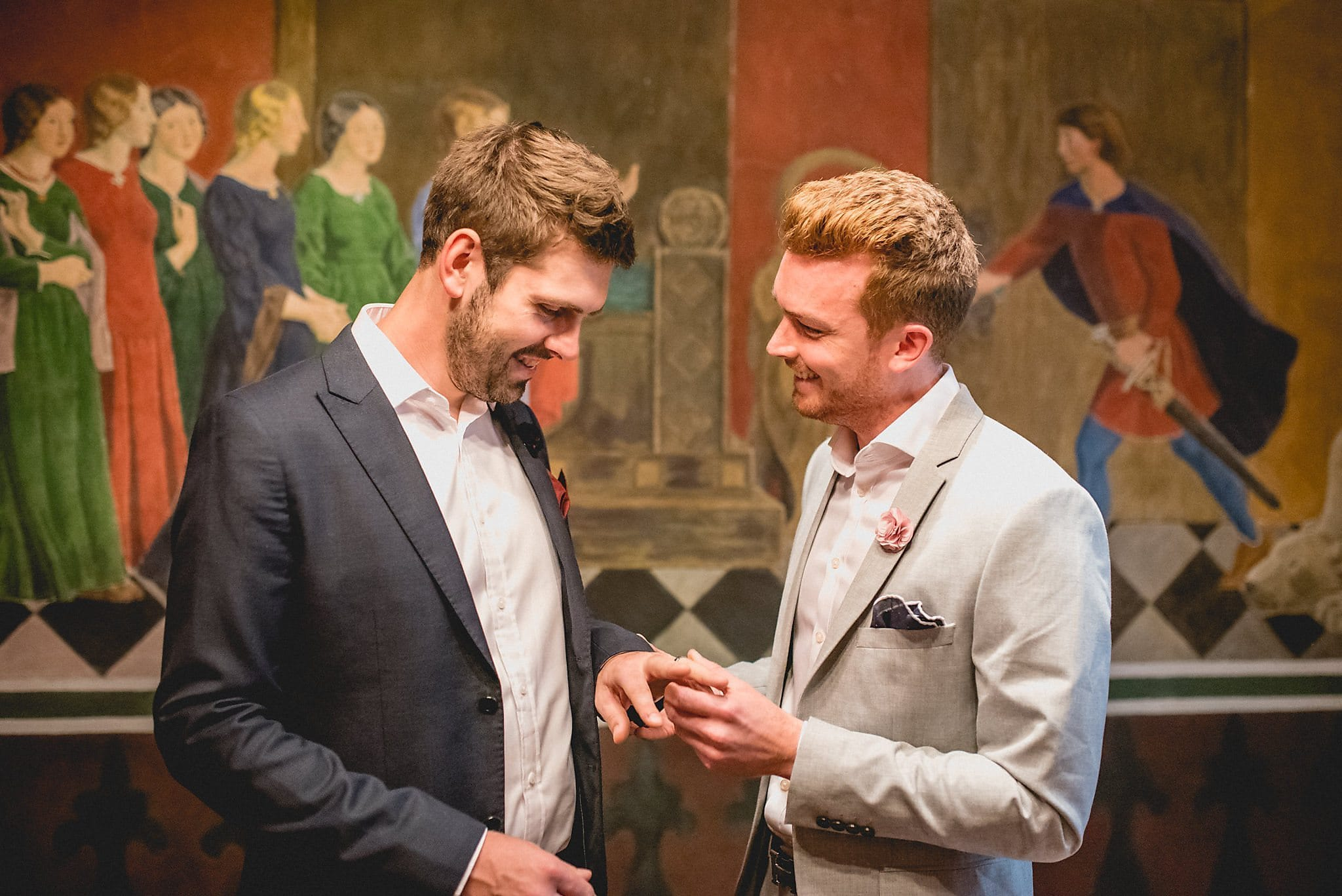 2 grooms exchange rings at their Elopement wedding at the Copenhagen Rådhus registry