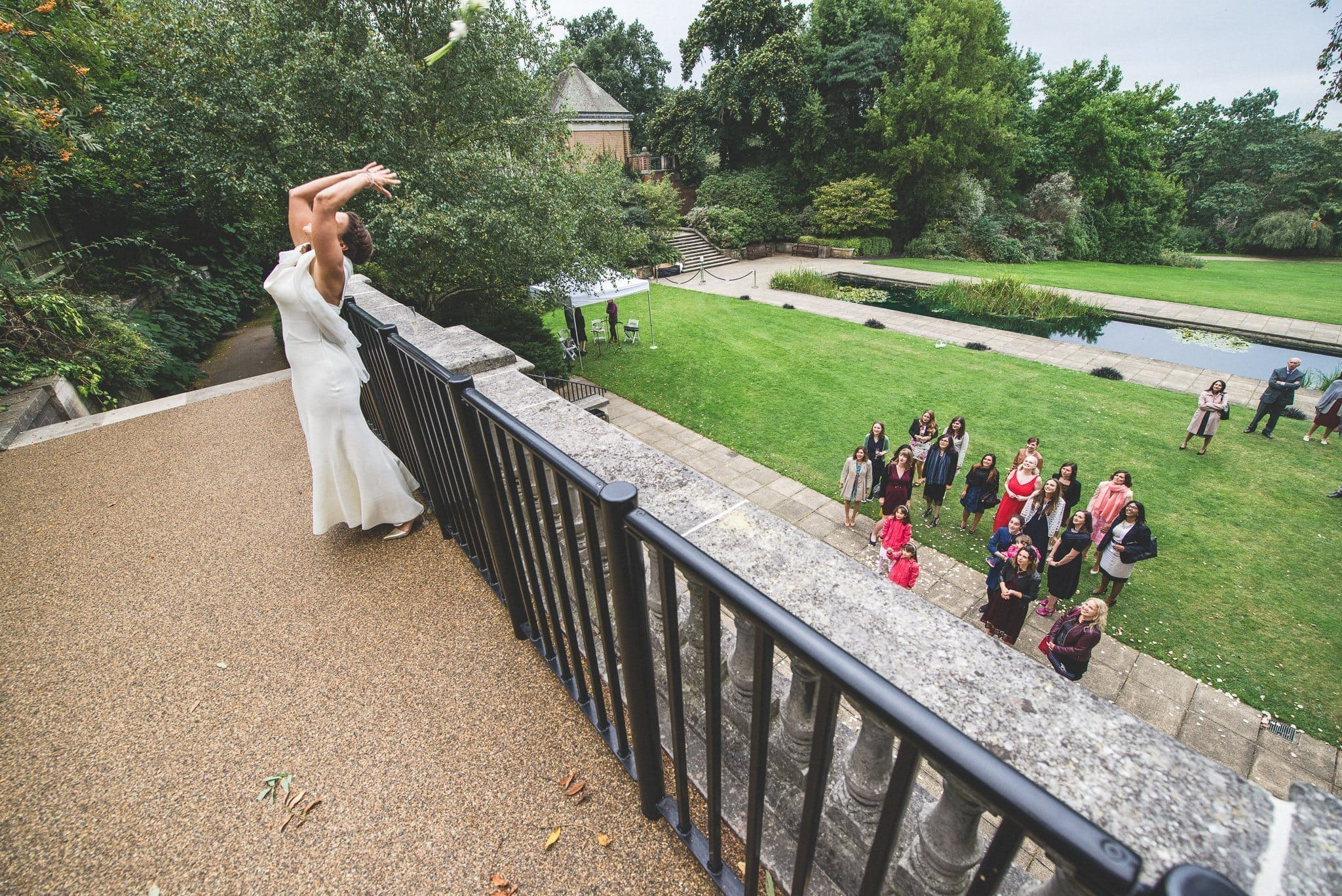 Ilaria throws her bouquet from a veranda at the Hampstead Heath pergola