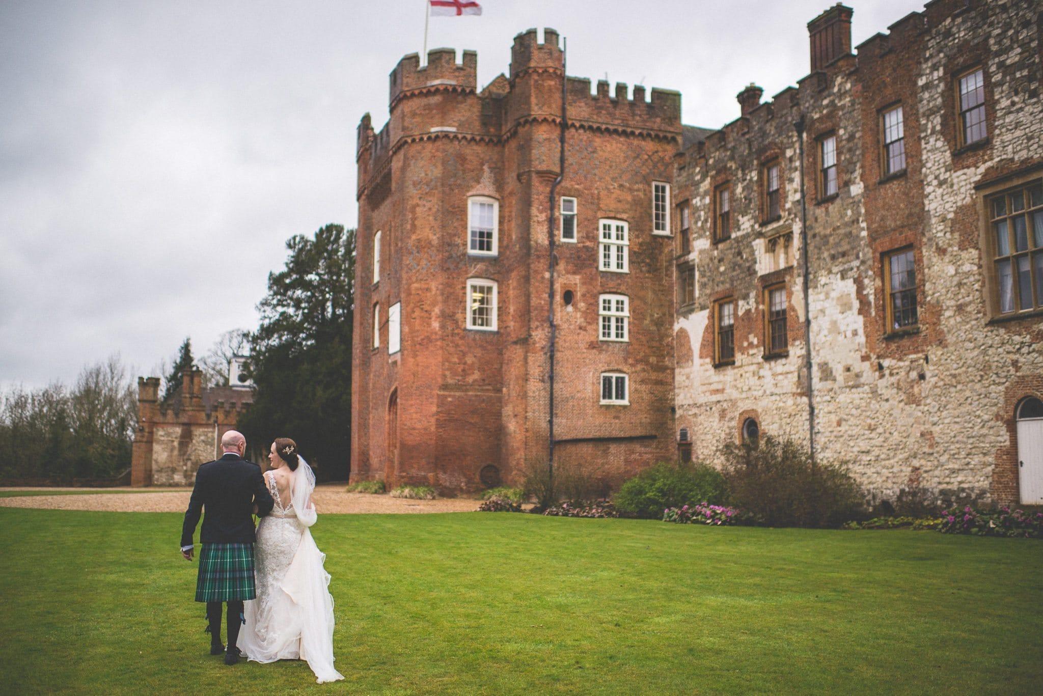 Bride and Groom walking towards Farnham Castle