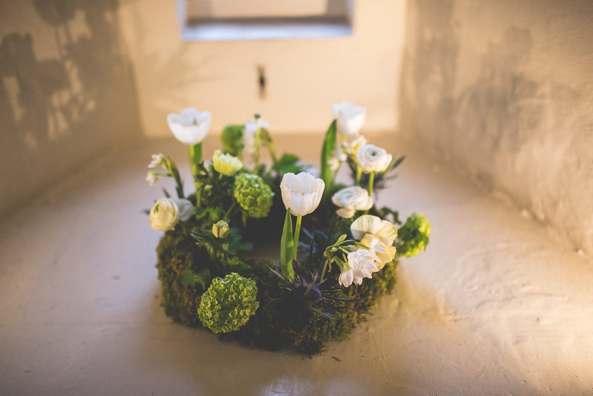 Spring floral ring arrangement at a Farnham Castle Wedding Lantern Hall