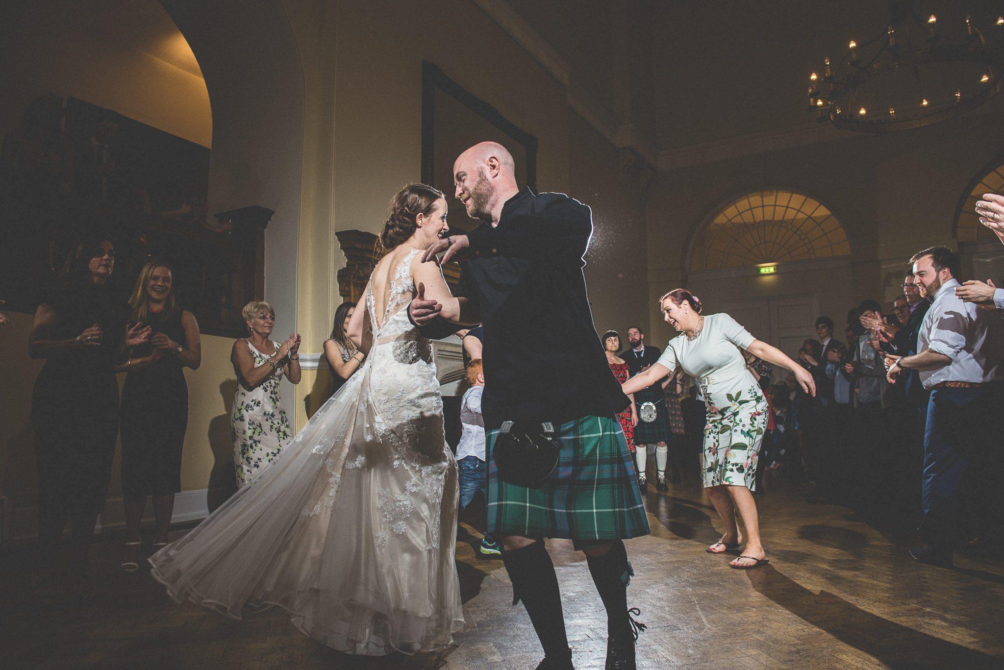 Bride and Groom dancing Ceilidh at their unique sci-fi Farnham Castle Wedding