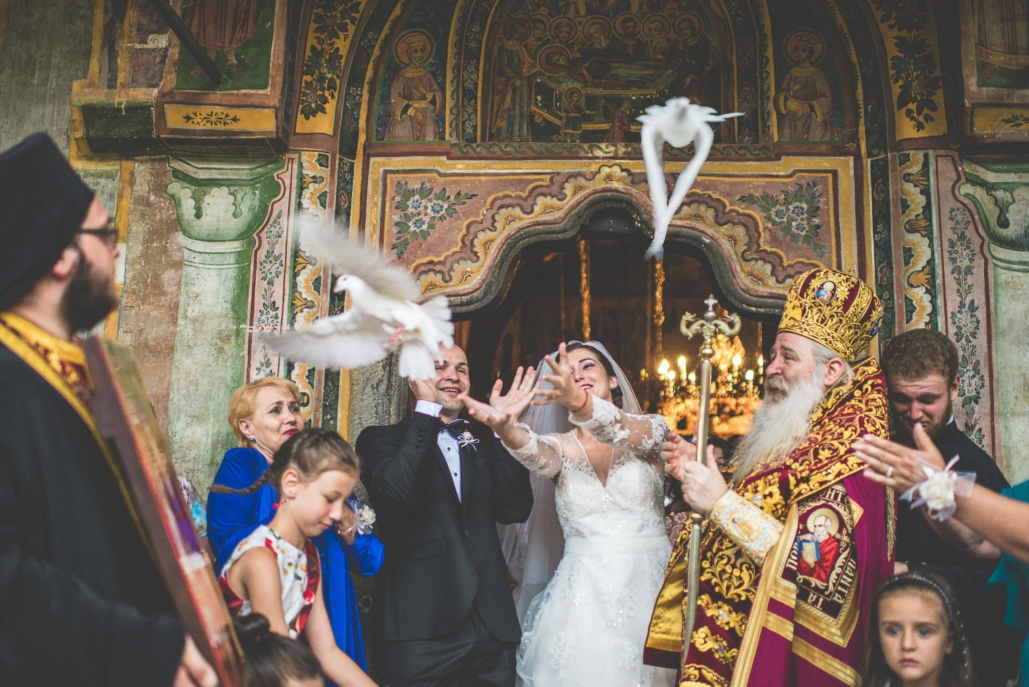The couple release white doves after their wedding ceremony.