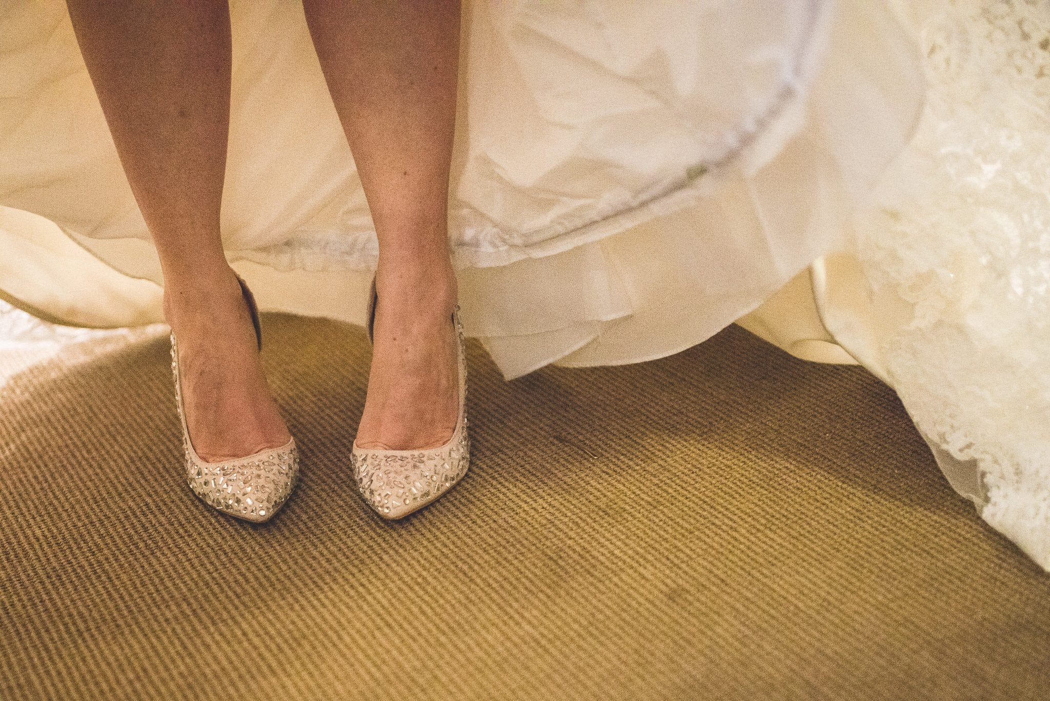 A shot of Emma's shoes underneath her dress