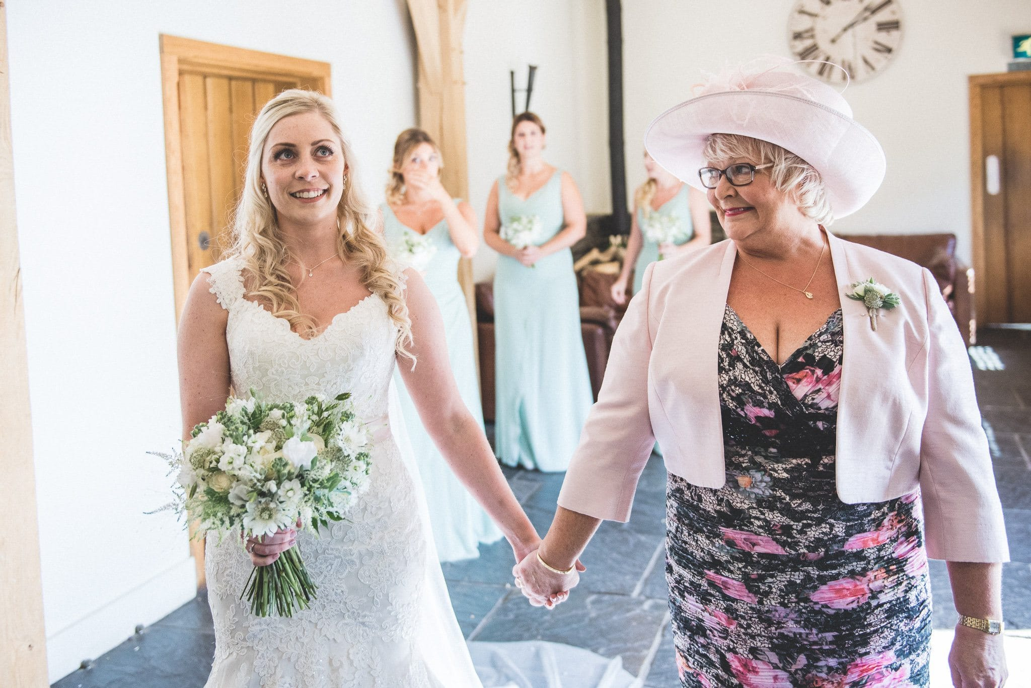 Emma holds hands with her mum on the way to the ceremony room