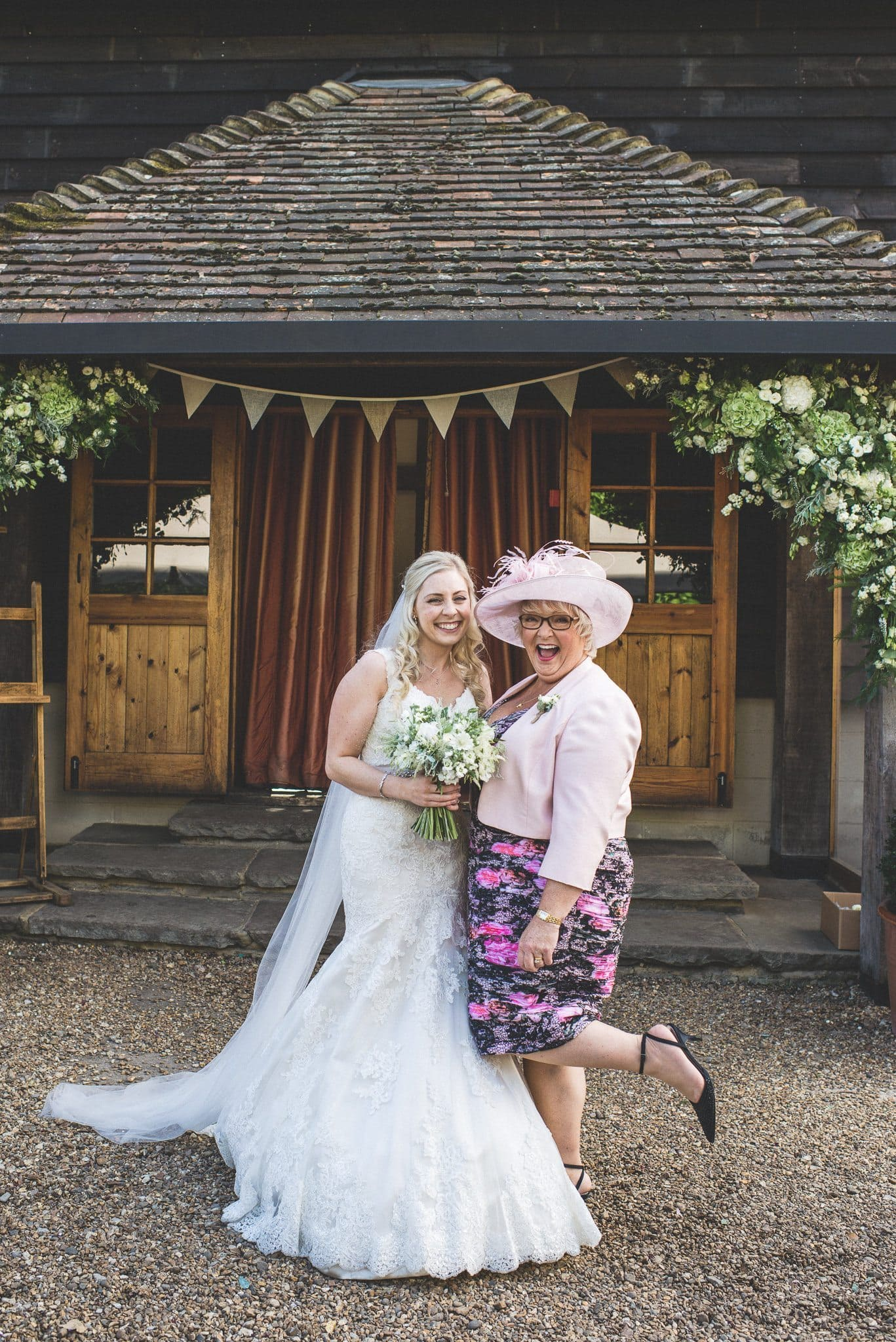 Newly married Emma poses with her mum, both grin at the camera