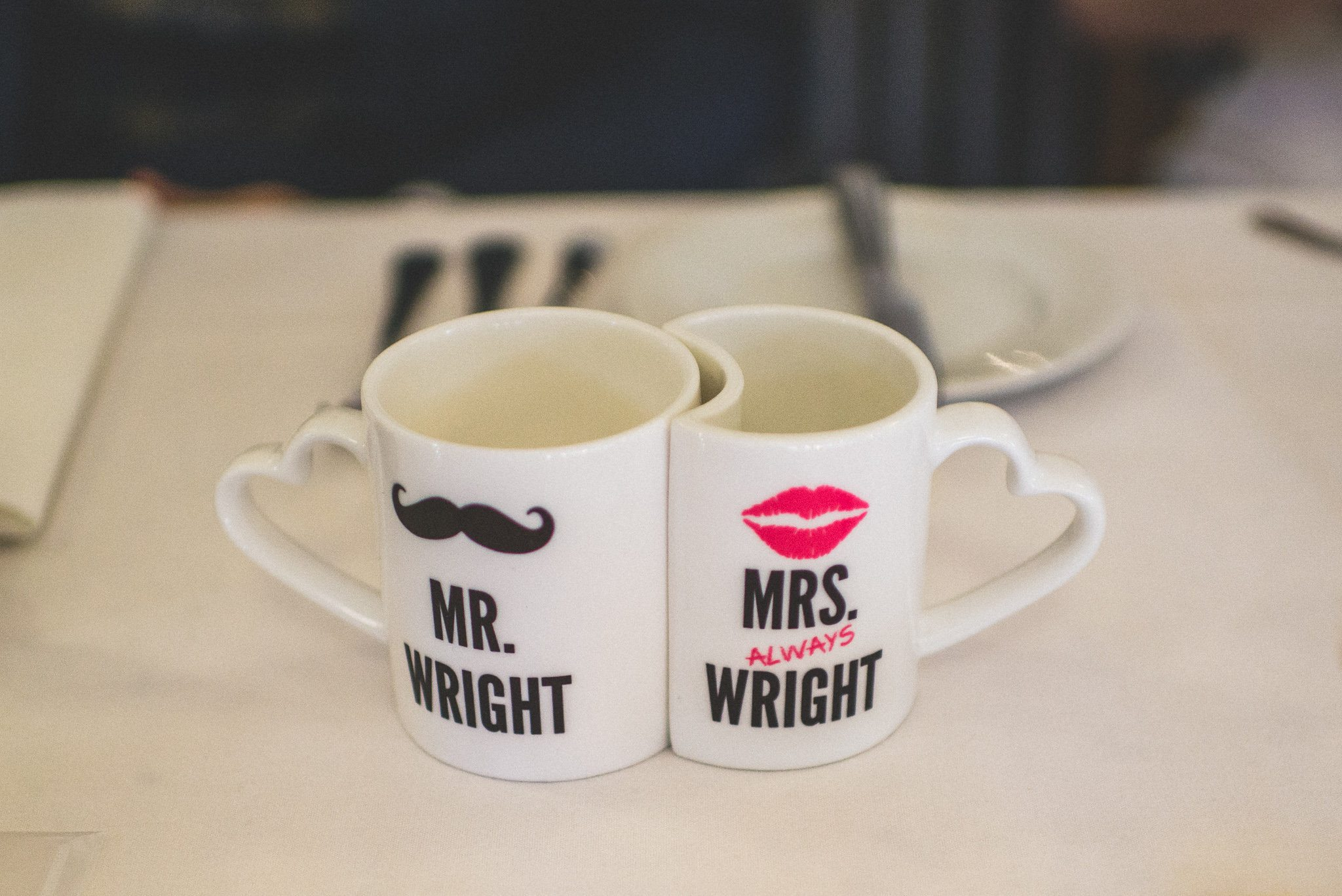 Two interlocking mugs with the couple's married name on them, one saying 'Mr Wright' and one saying 'Mrs Always Wright'