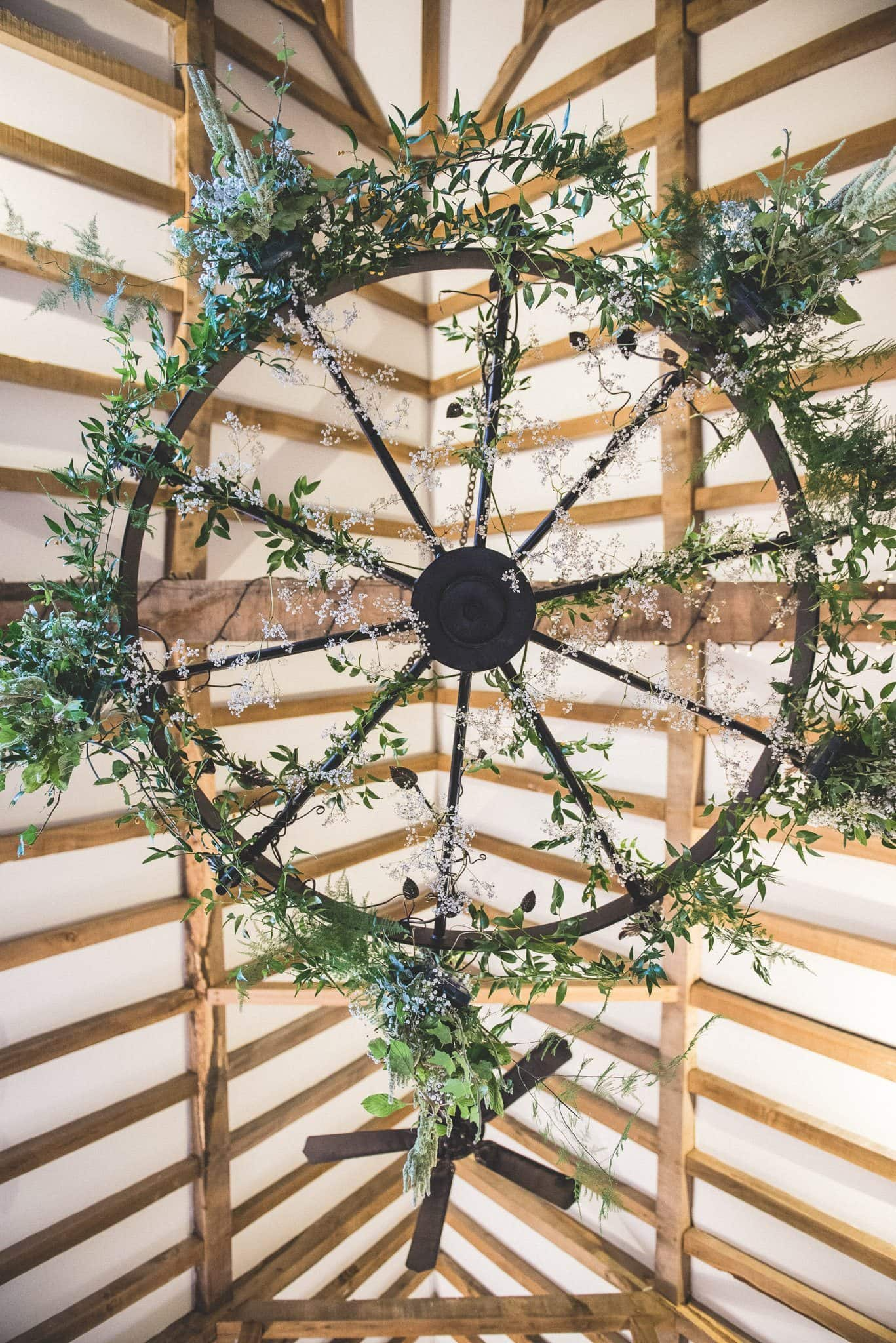 A shot for directly underneath one of the foliage chandeliers, looking up into the rafters of the barn