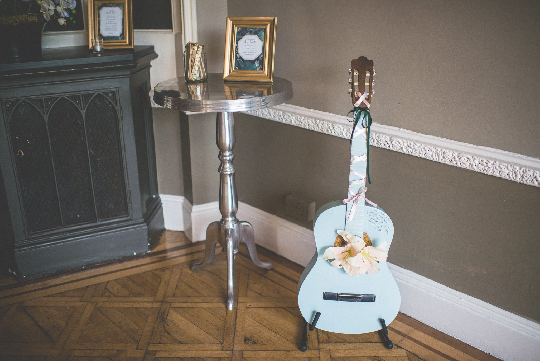 A pale blue guitar serves as the couple's guestbook.