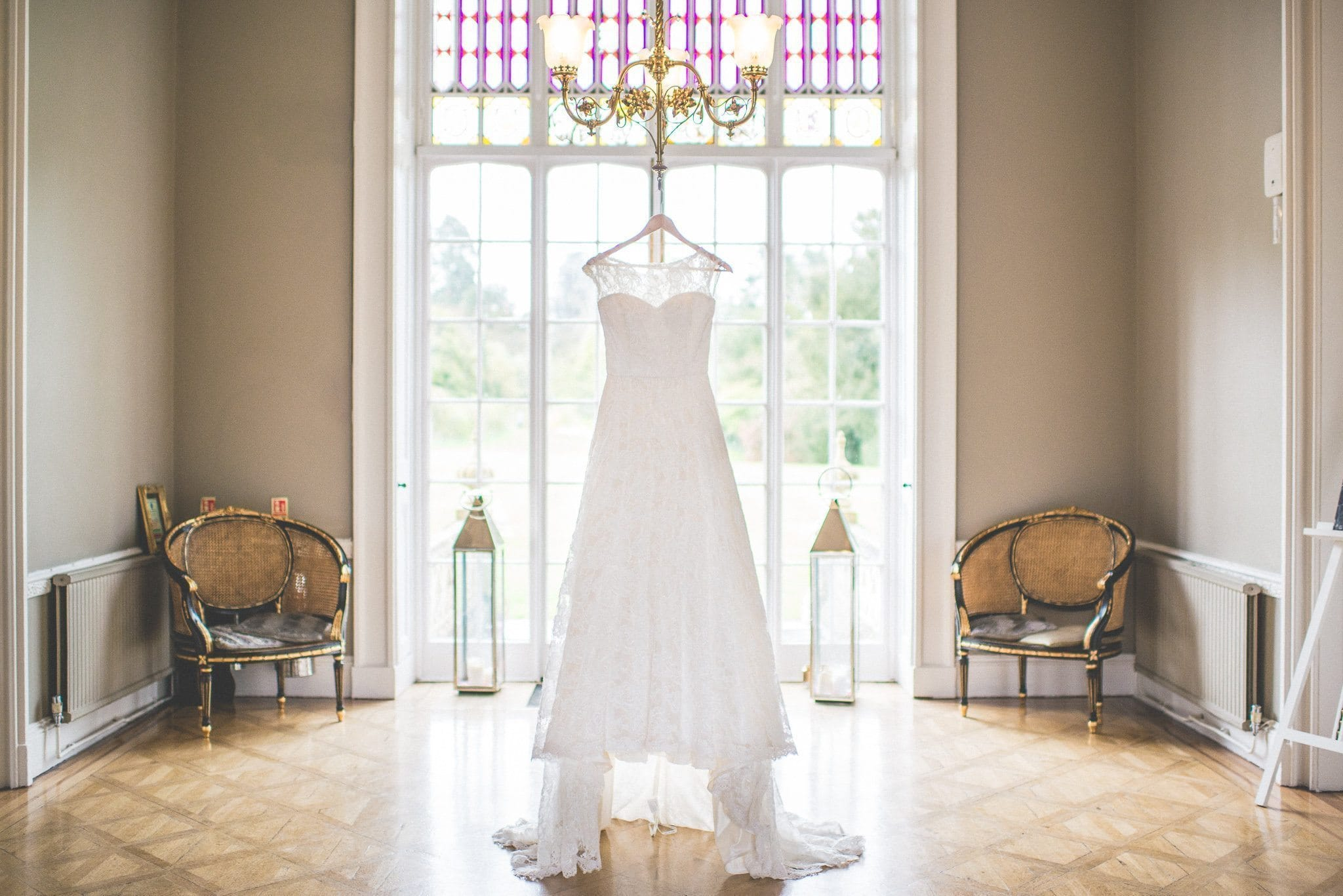 Jasmin's dress hangs from a chandelier on the morning of her emotional Nonsuch Mansion wedding