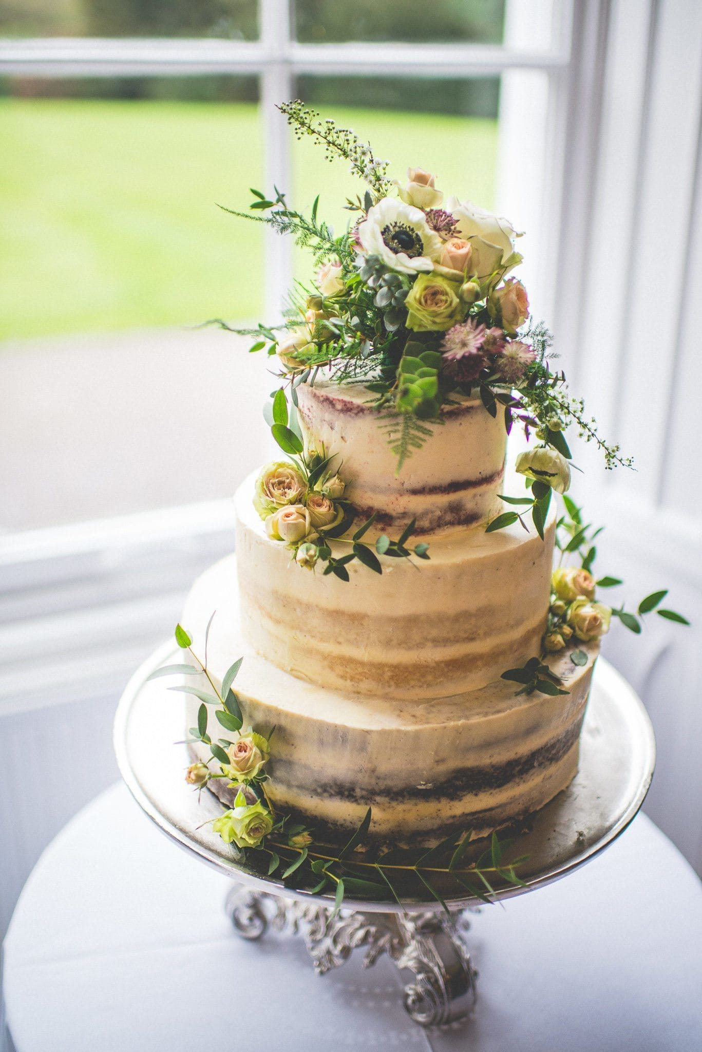 The semi-naked cake, with different flavoured sponge on each tier. It is decorated with beautiful fresh flowers.