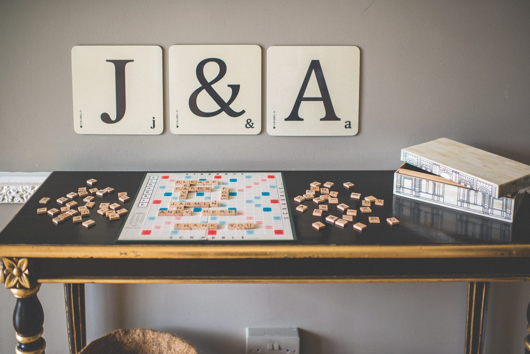Jasmin and Andy's gift and card table, with instructions spelled out in Scrabble tiles and large J & A scrabble tiles on the wall behind it