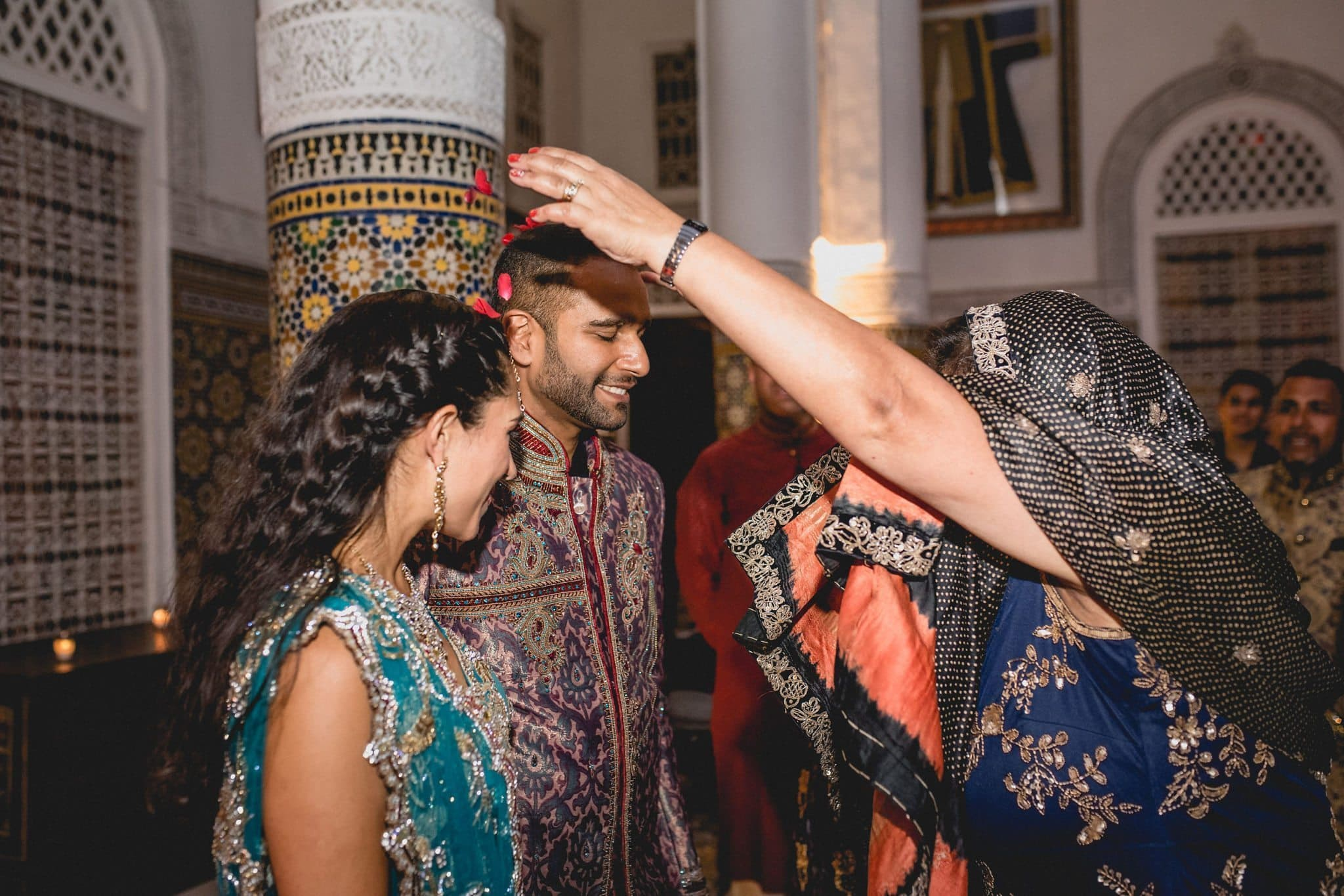 Indian Mother blessing her son and new daughter in law on their Marrakech destination wedding day