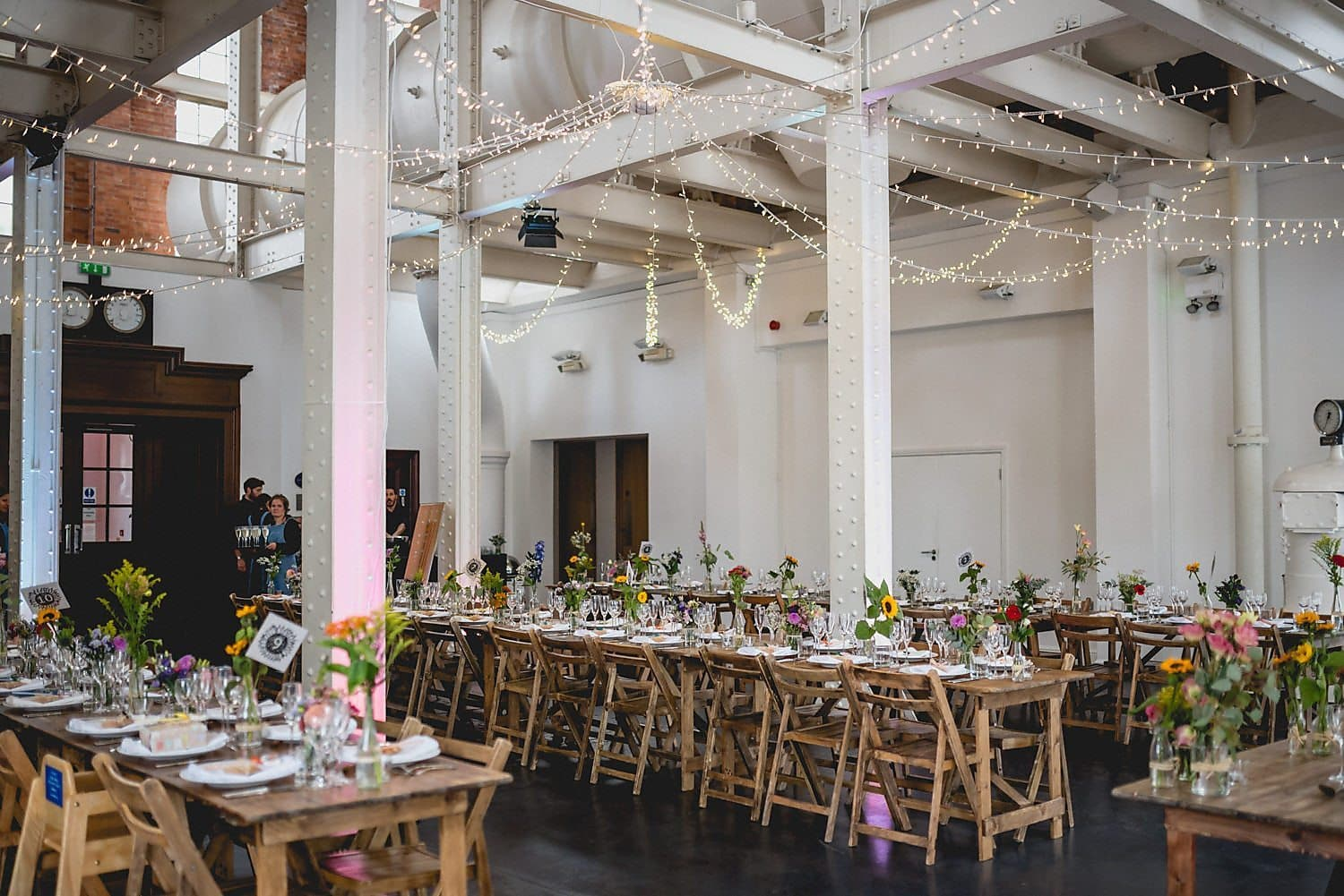 Start Wedding Planning for a Beautifully decorated West Reservoir Centre including festoon lights, trestle tables and lots of colourful flowers