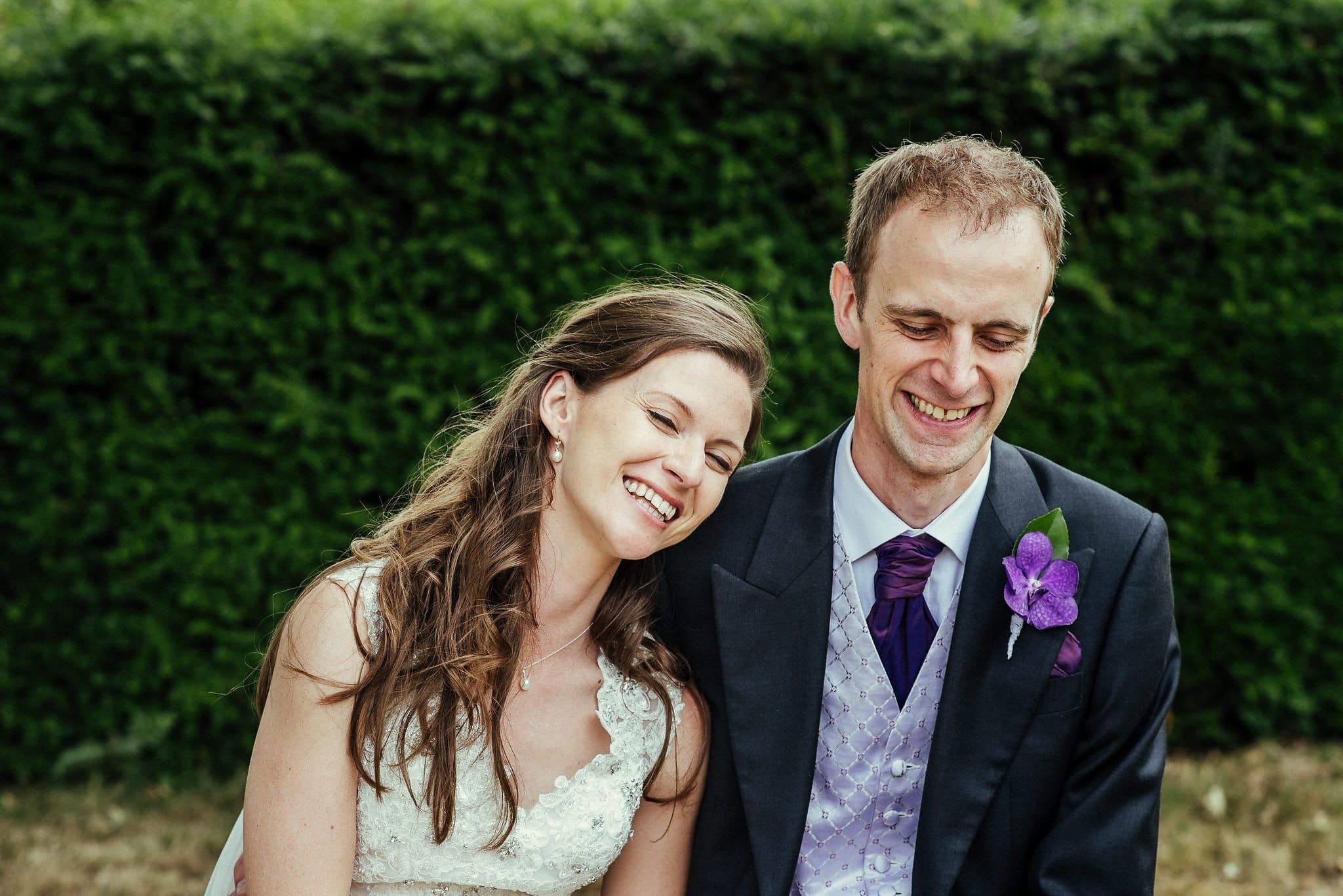 Bride and groom laughing at Dorney court