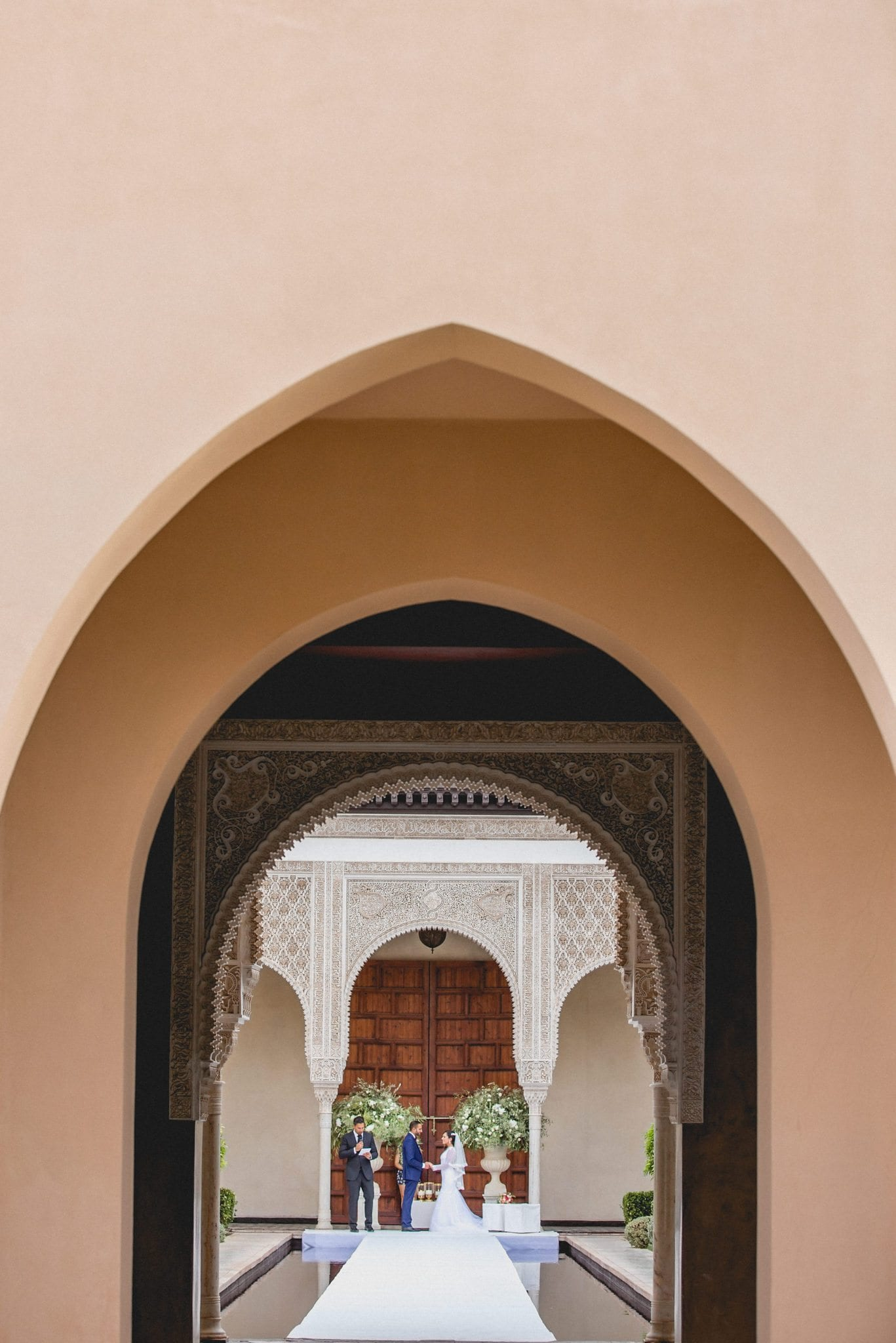 Bride and Groom getting married at their Ksar Char Bagh Luxury Marrakech Destination Wedding