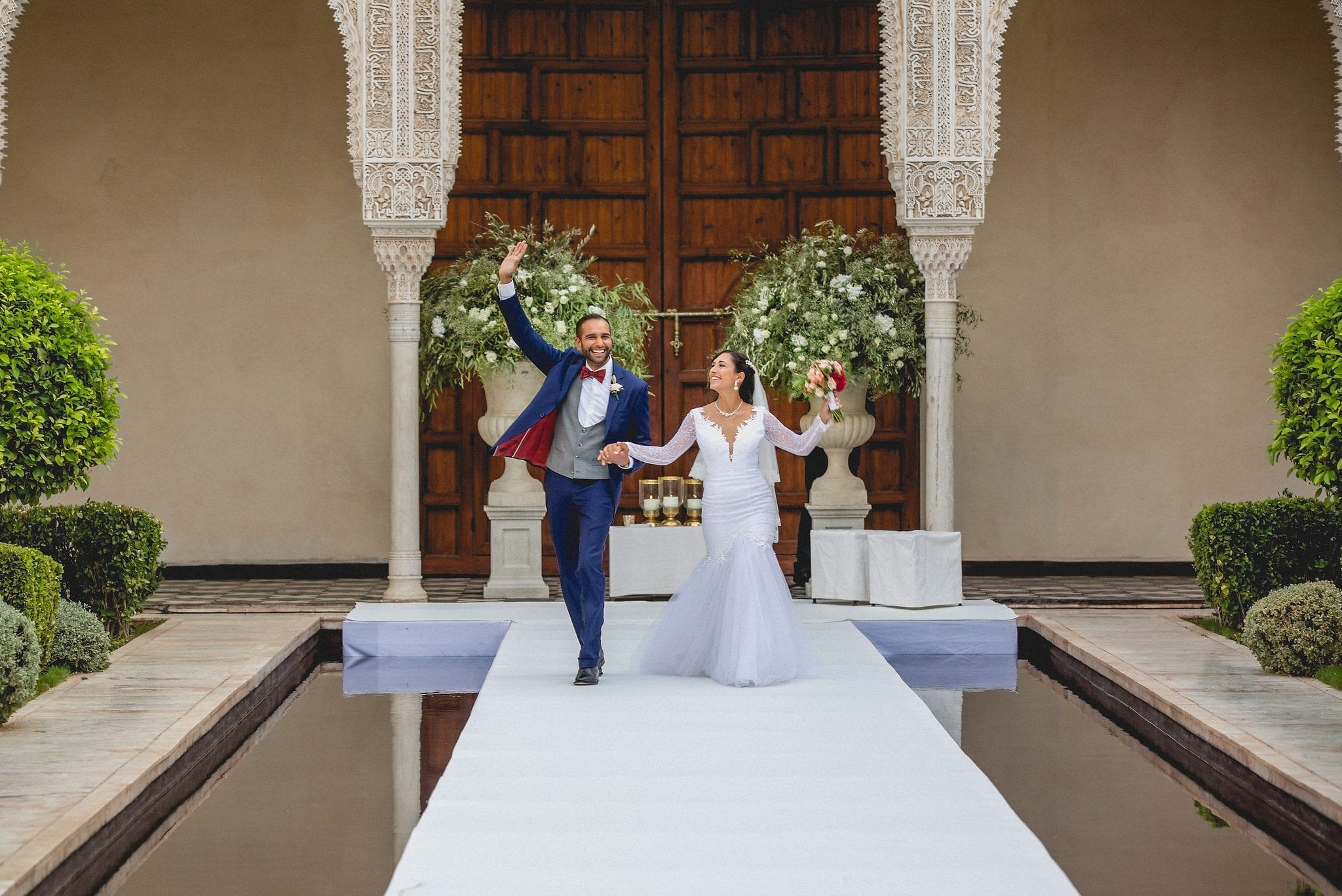 The Bride and Groom dance back down the aisle as husband and wife at Ksar Char Bagh