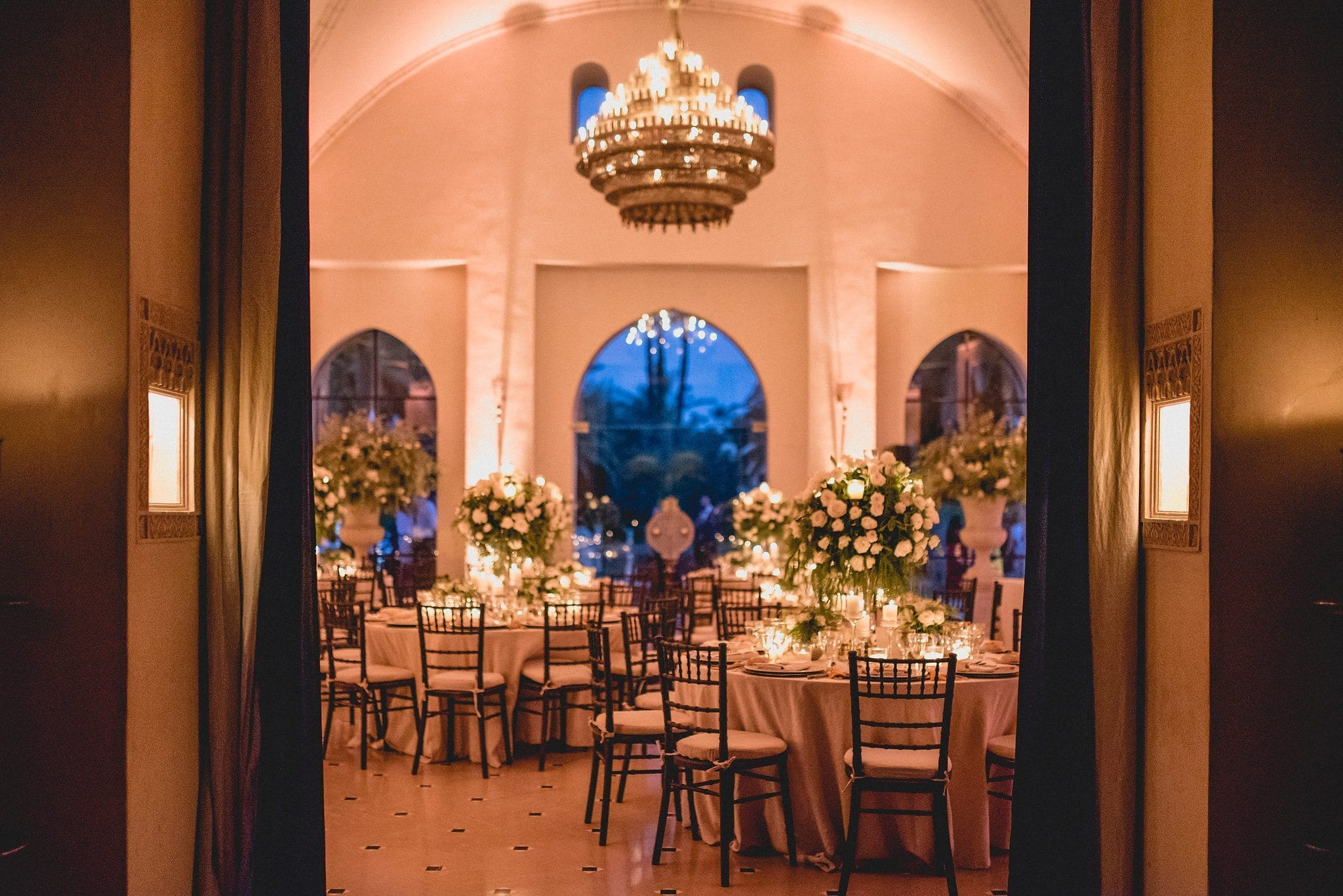 Ksar Char Bagh dining hall decorated with candles and local flowers for a destination wedding
