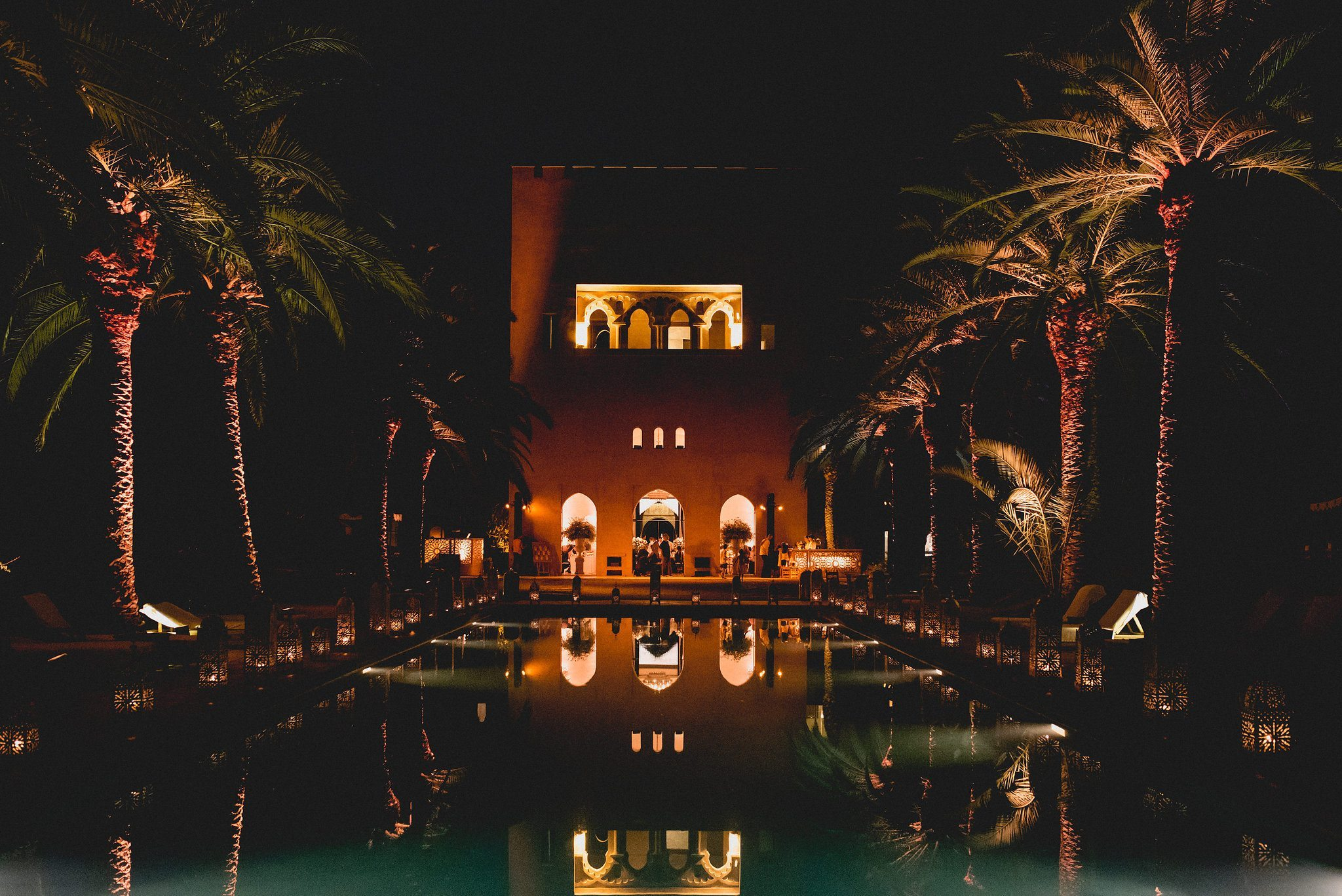 Moroccan Destination Wedding at Ksar Char Bagh reflected in the pool