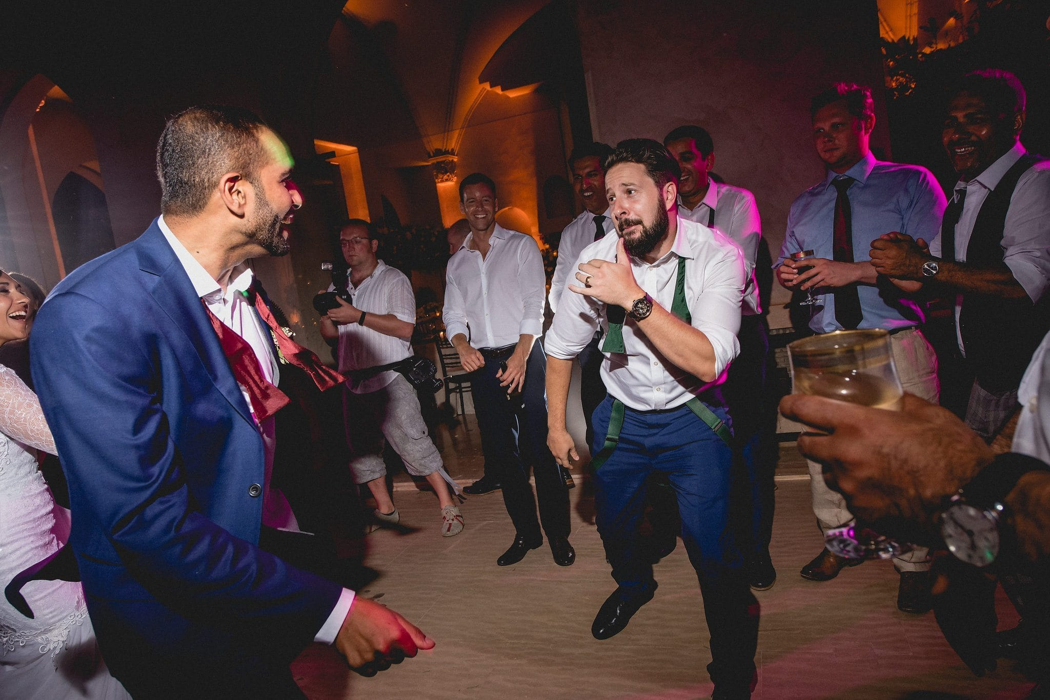 A challenge is thrown down for a dance off between a groomsman and the groom at Ksar Char Bagh