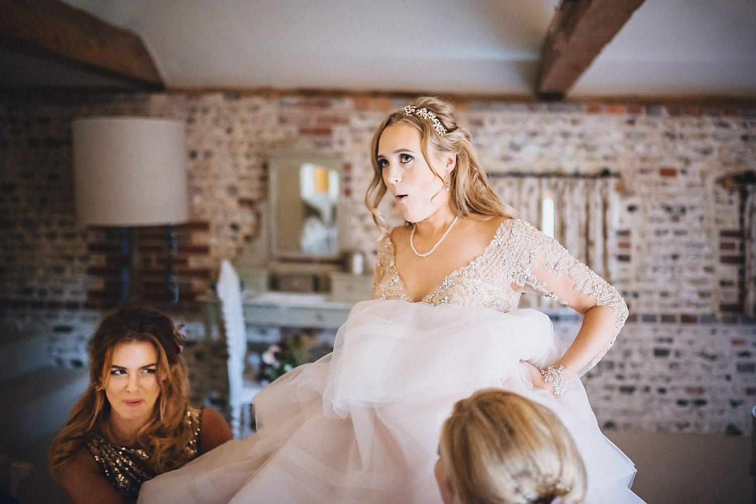 An action shot of the bride getting into her Martina Liana wedding gown