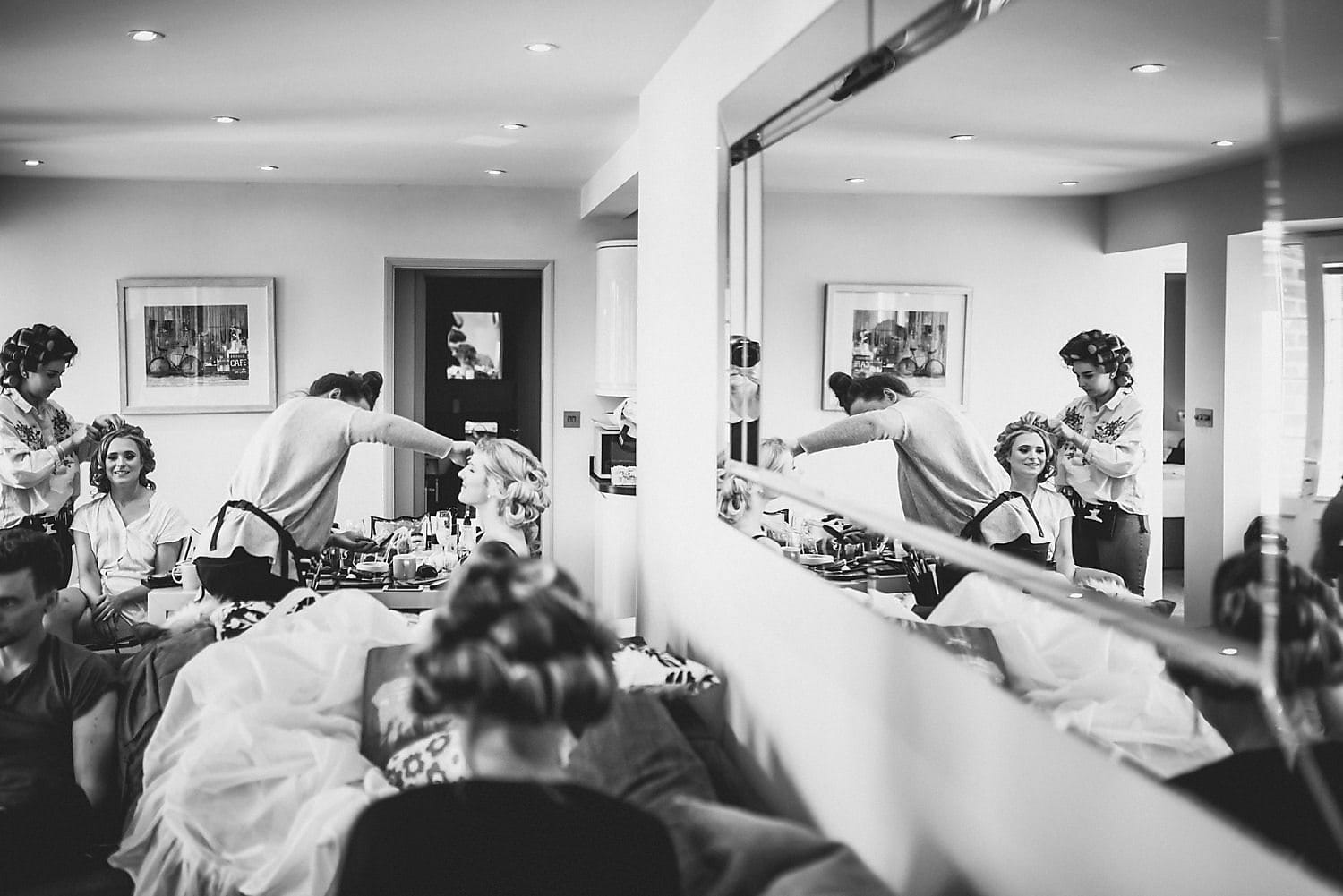 The bride and bridesmaids get ready together