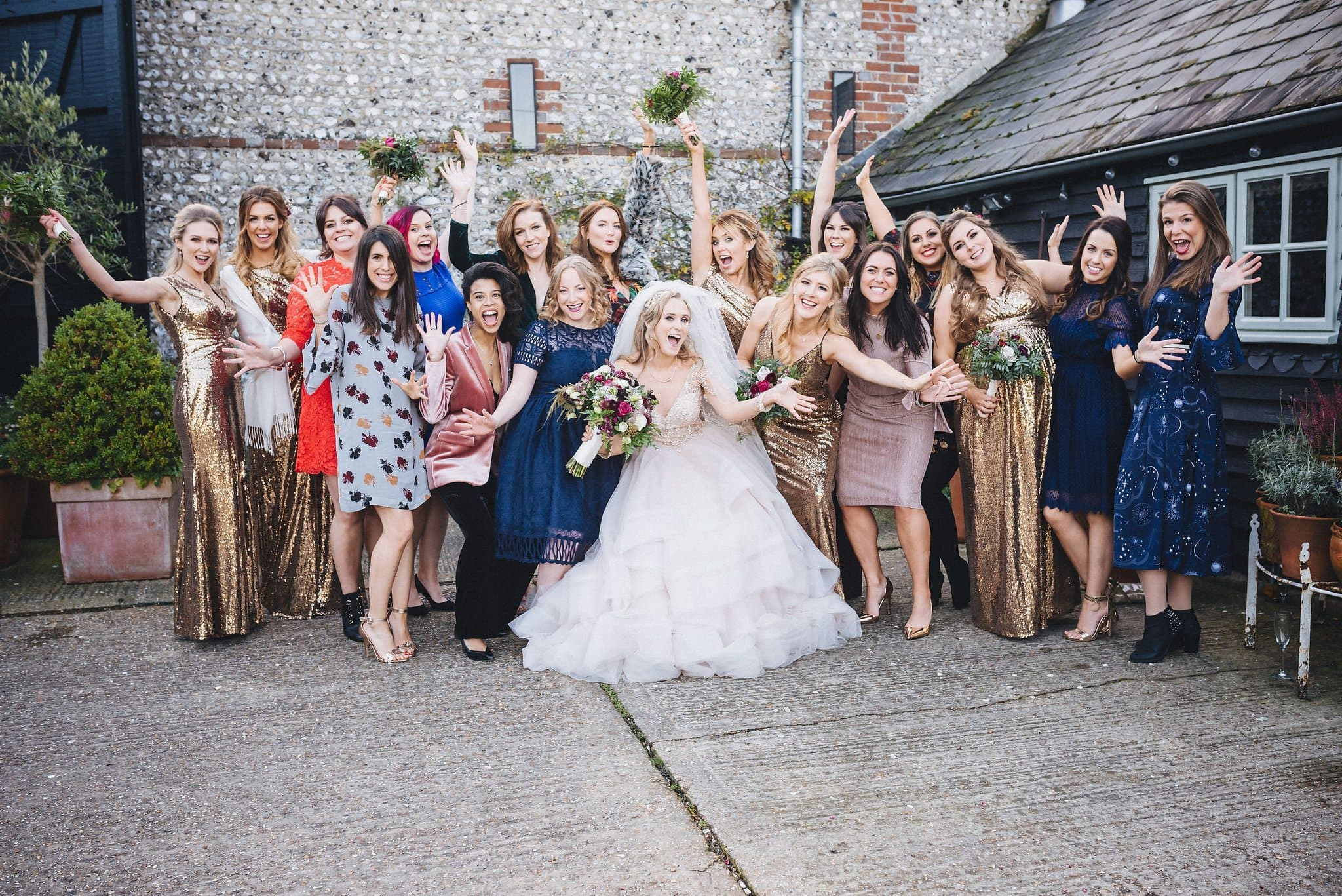 Bride laughing with her girlfriends at Upwaltham Barns