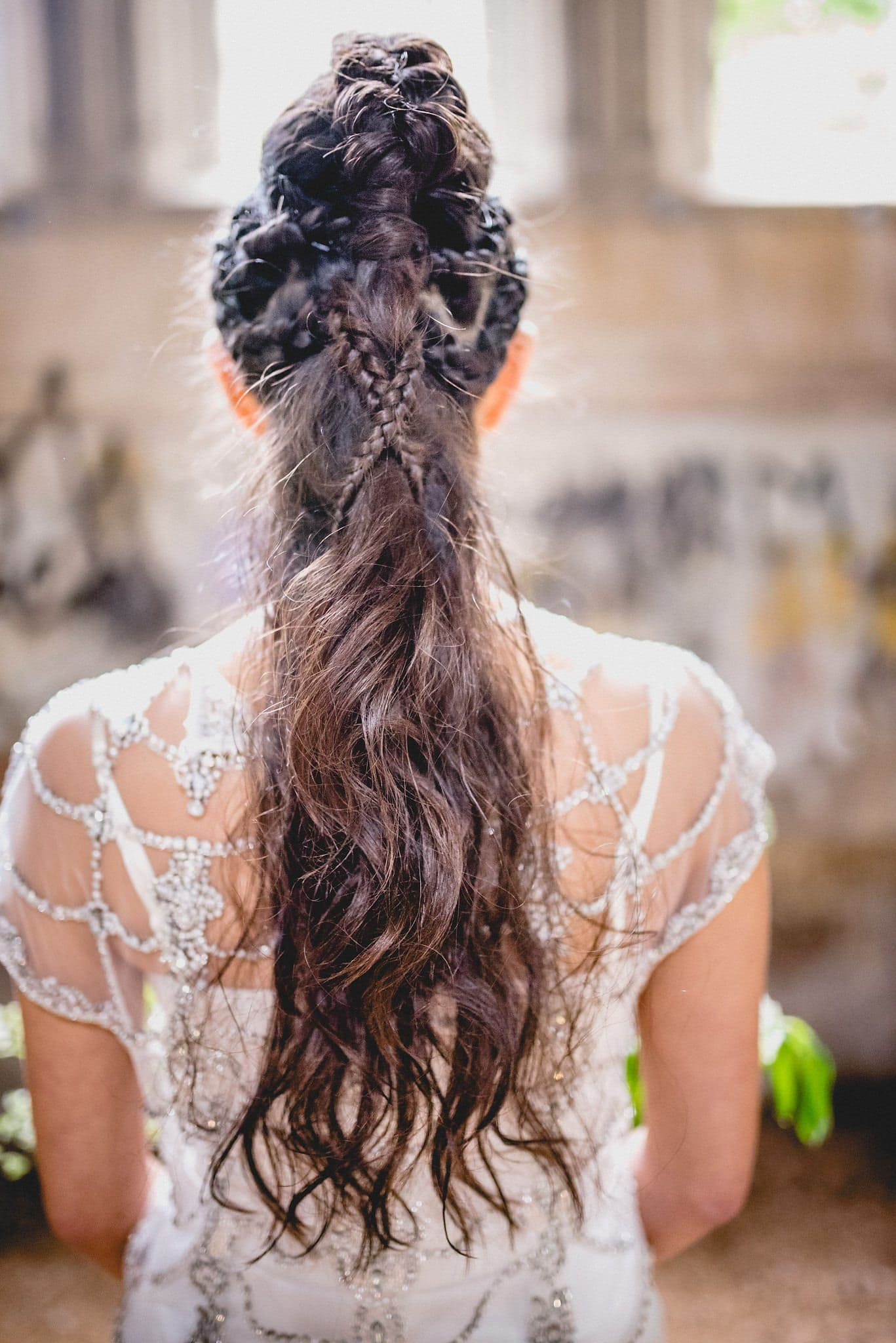 A shot from behind showing the amazing braided mohican hairstyle on our bridal model Rebecca